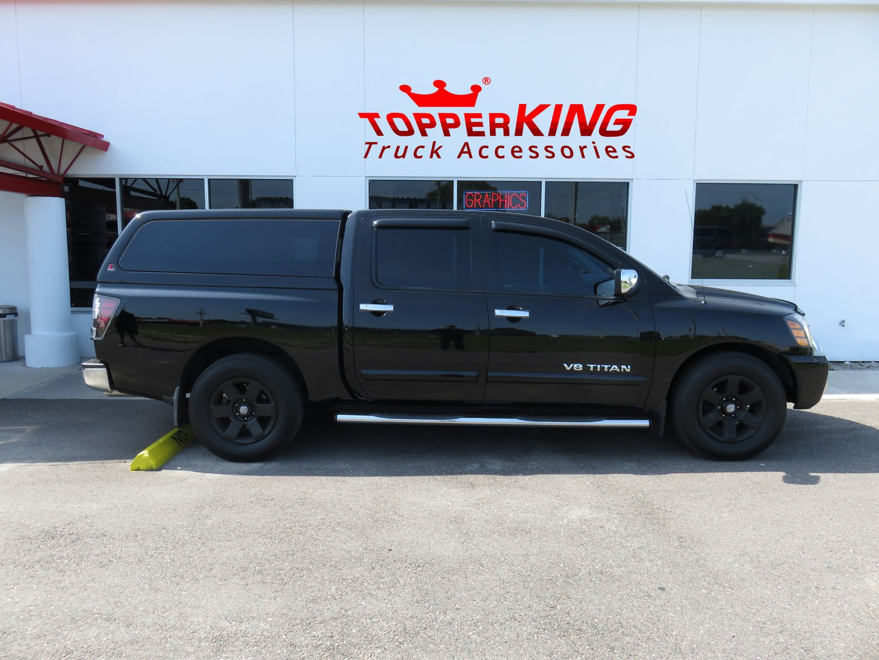 Nissan Titan LEER 100XQ fiberglass topper and Stainless Steel Nerf Bars by TopperKING in Brandon, FL 813-689-2449 Call today to start on your truck!