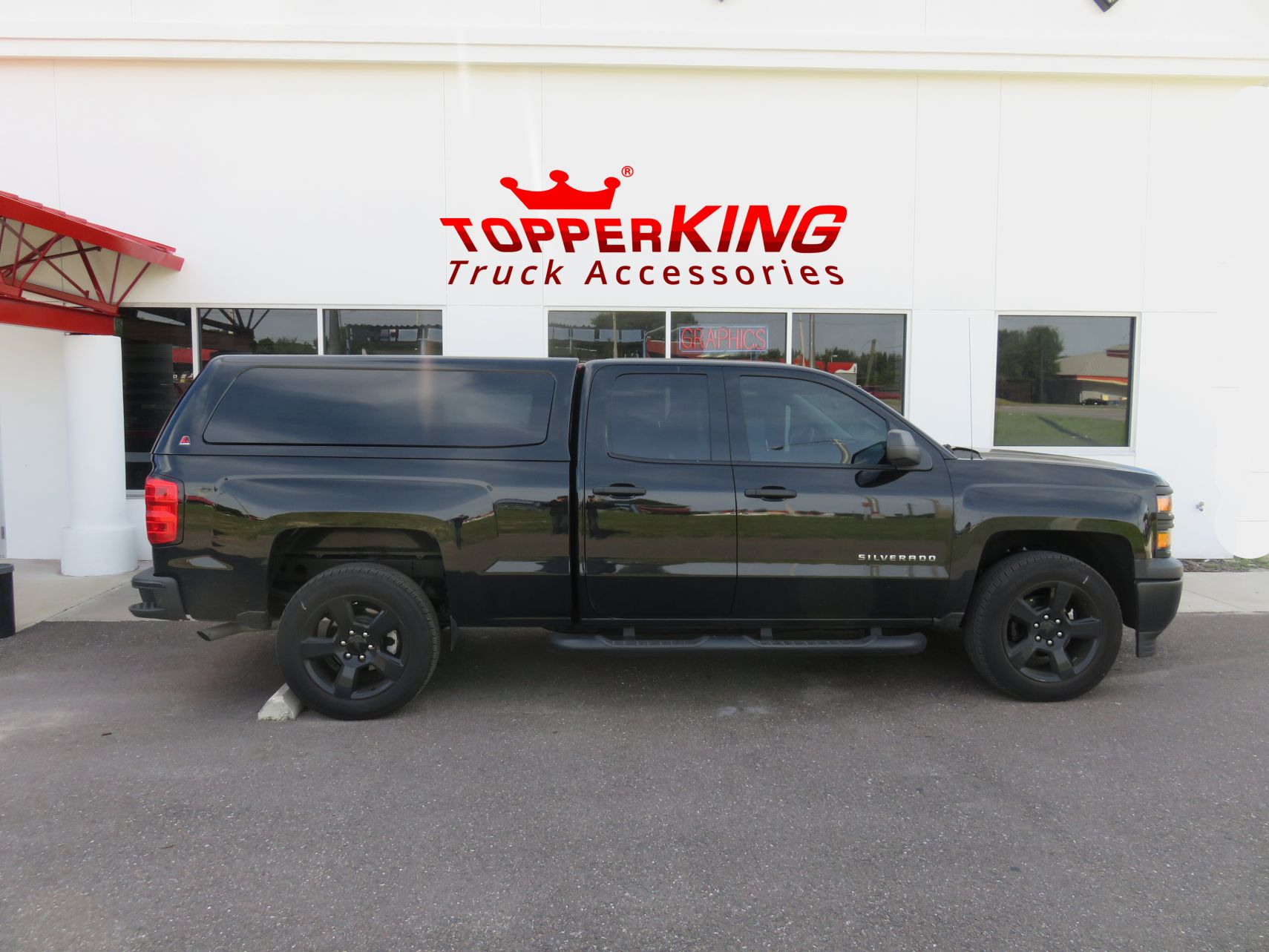 Chevy Silverado LEER 100XQ fiberglass topper and a custom hitch by TopperKING in Brandon, FL 813-689-2449 Call today to start on your truck!