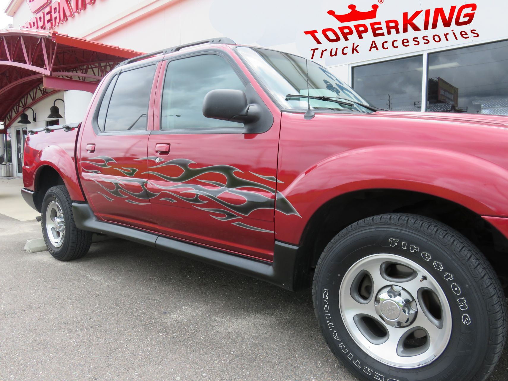 Ford Explorer Sport Tracsmokin' hot graphics by TopperKING in Brandon, FL 813-689-2449 Call today to start on your truck!
