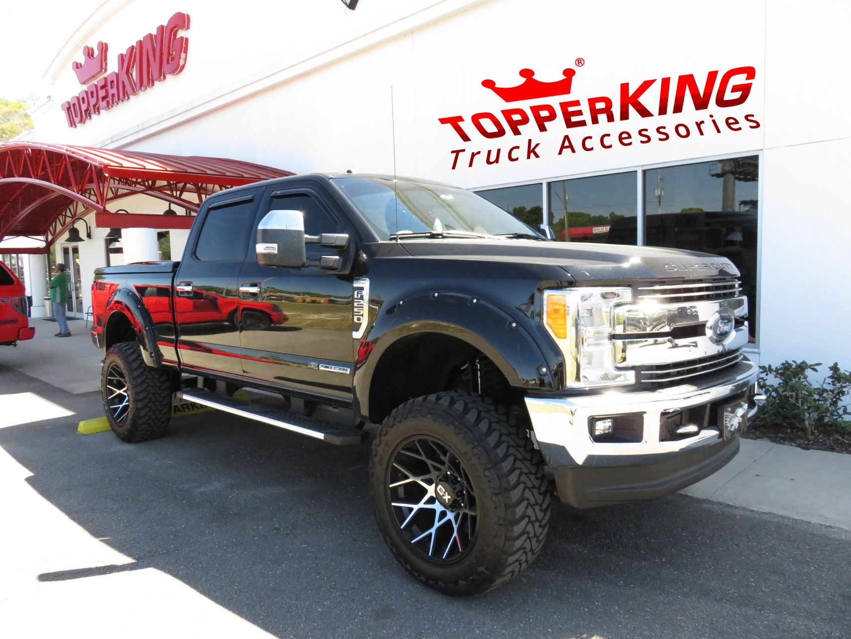 Ford f250 leer 700 fiberglass lid and a custom hitch by topperking in brandon fl