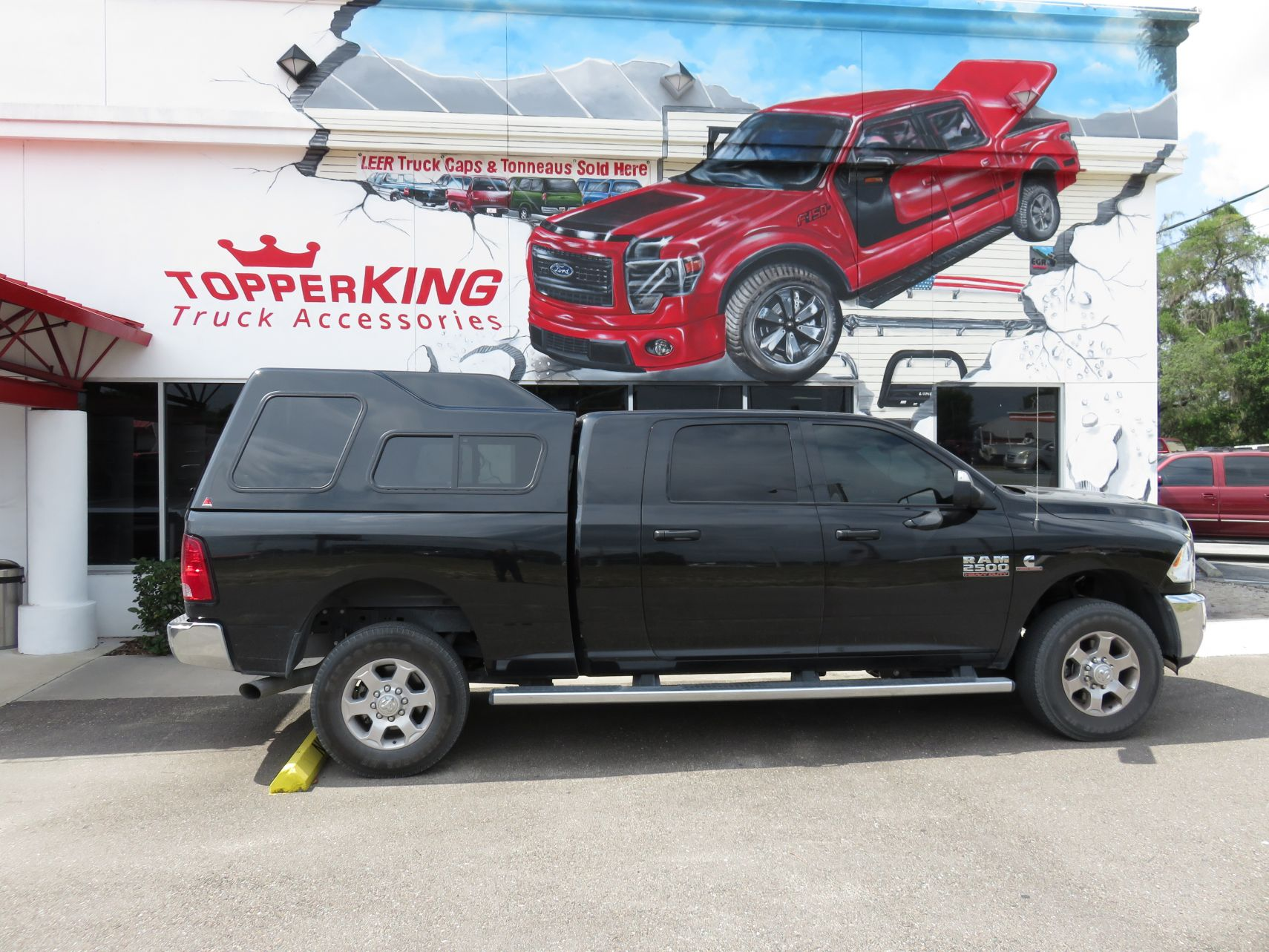 Dodge RAM 2500 LEER 122 fiberglass topper and a custom hitch by TopperKING in Brandon, FL 813-689-2449 Call today to start on your truck!