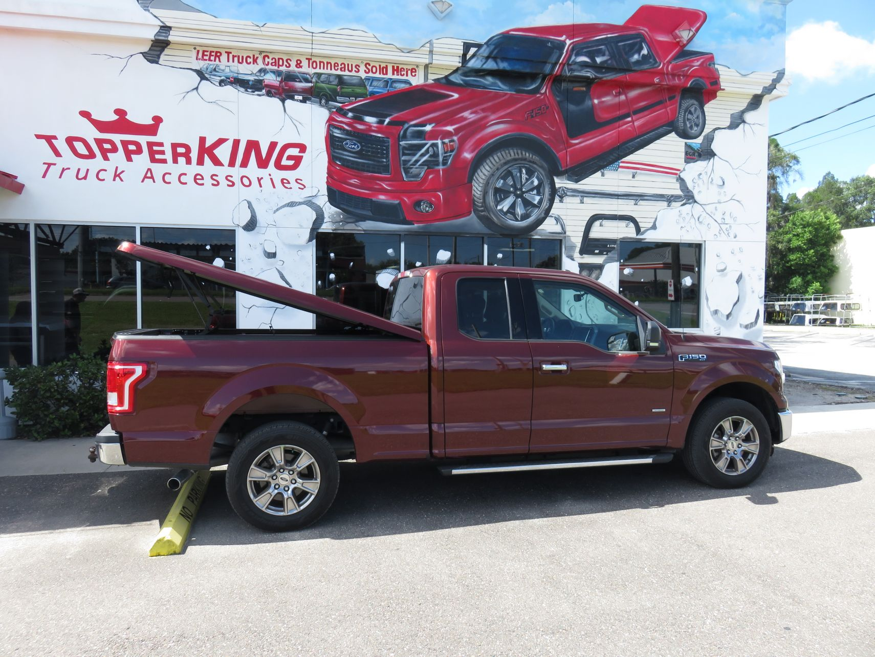 2015 Ford F150 with Leer 550 Fiberglass Tonneau, Nerf Bars, Tint, Chrome, Hitch by TopperKING in Brandon, FL 813-689-2449 or Clearwater, FL 727-530-9066. Call today!