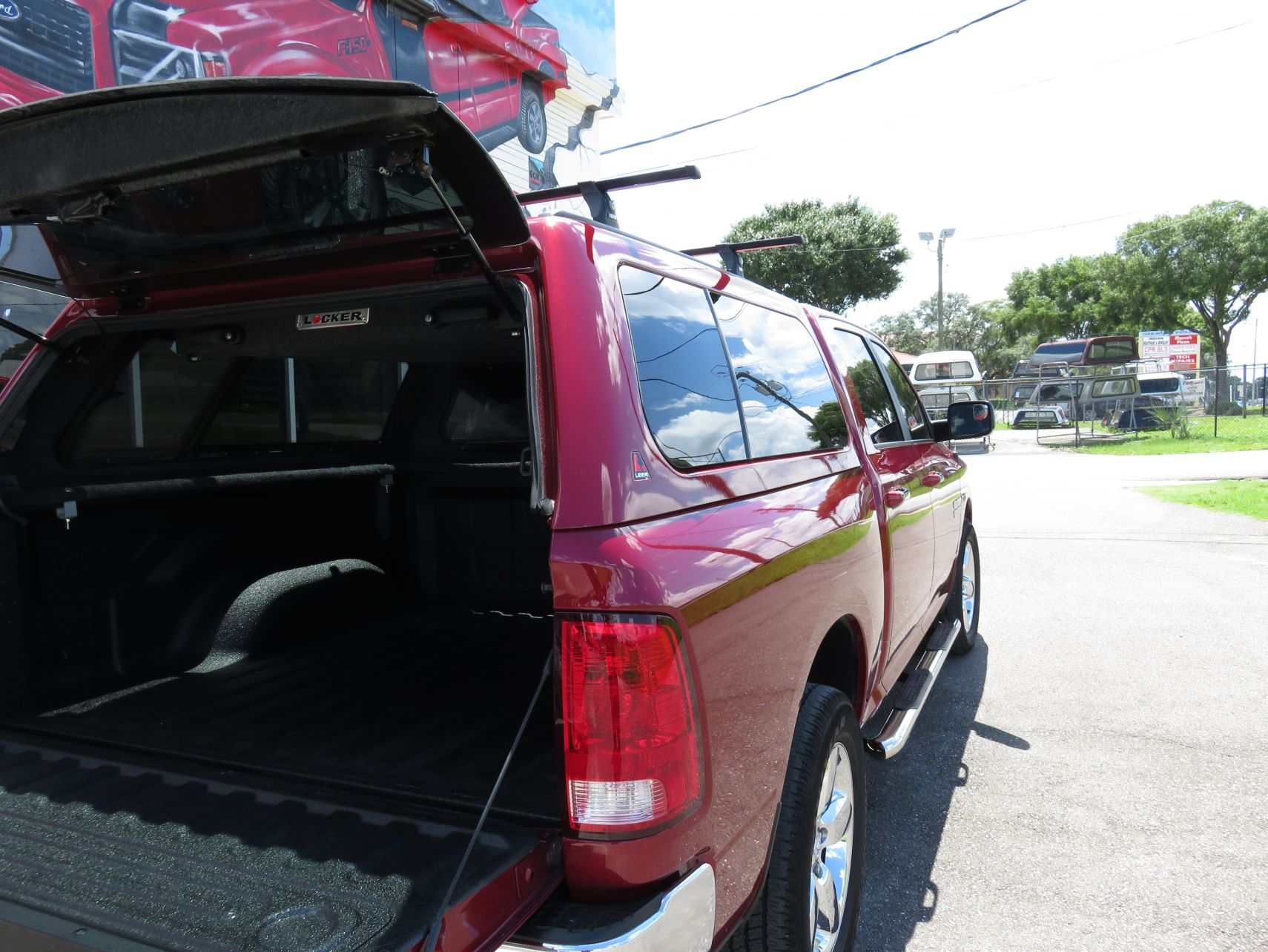 2015 Red Dodge RAM 1500 Leer 100XL, Leer Locker, Nerf Bars, hitch by TopperKING in Brandon, FL 813-689-2449 or Clearwater, FL 727-530-9066. Call today!