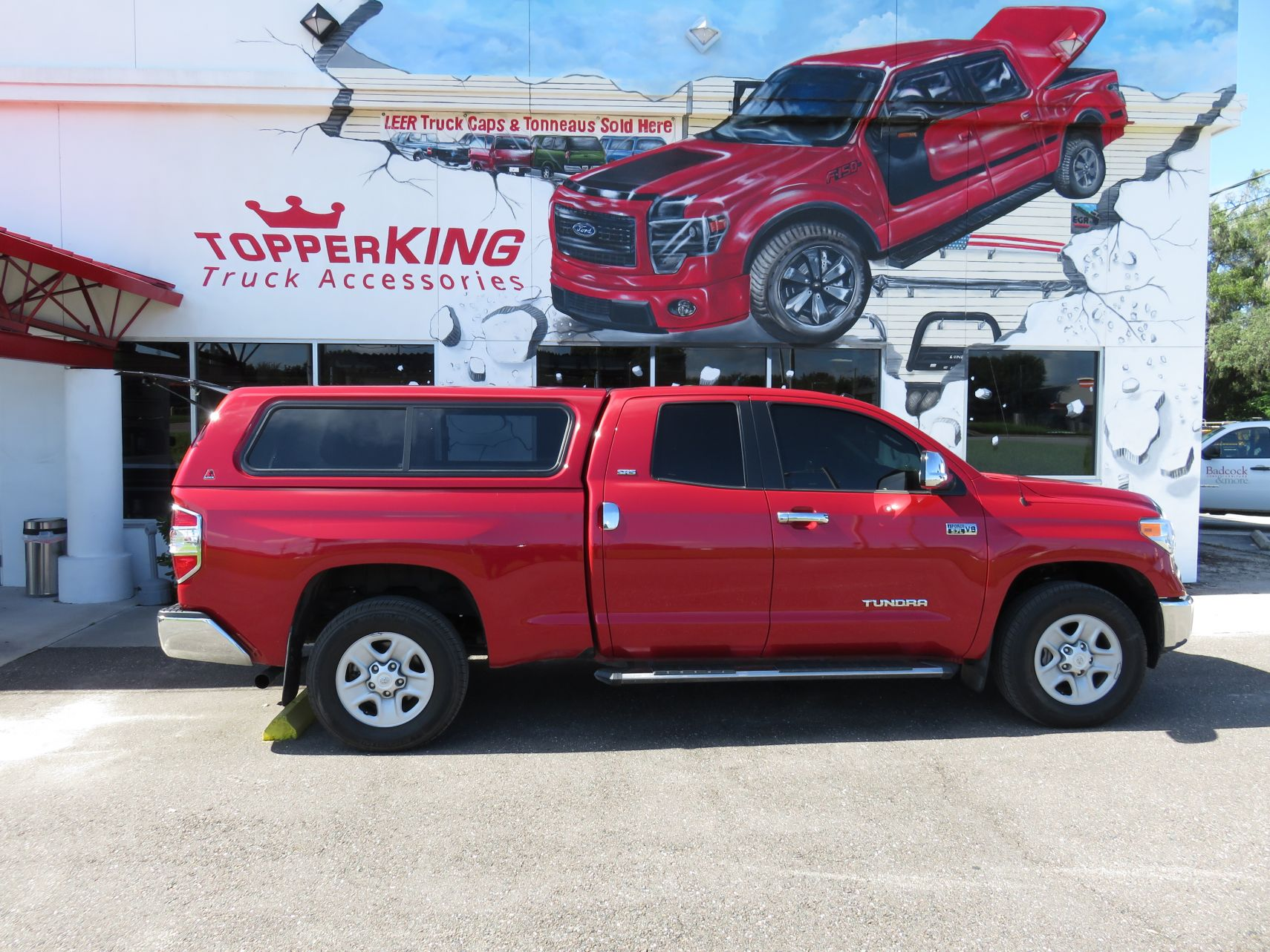 2016 Toyota Tundra with Leer 100XR, Nerf Bars, Chrome, Tint, Custom Hitch by TopperKING in Brandon, FL 813-689-2449 or Clearwater, FL 727-530-9066. Call Today!