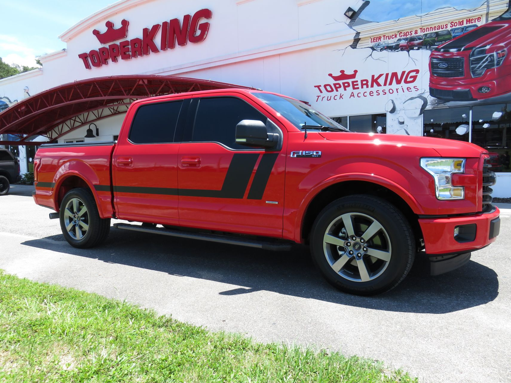 2017 Ford F150 with Soft Tonneau, Graphics, Running Boards, Tint, and Custom Hitch by TopperKING in Brandon, FL 813-689-2449 or Clearwater, FL 727-530-9066. Call today!