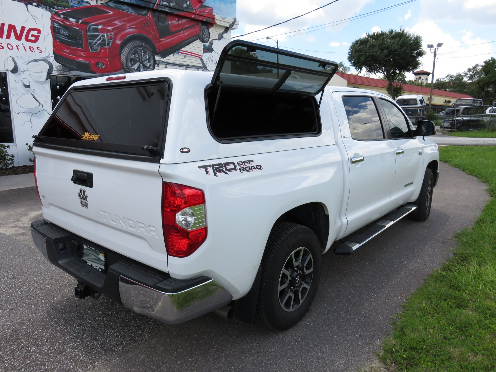2017 Toyota Tundra with Ranch Echo, Windoor, Nerf Bars, Tint, Custom Hitch by TopperKING in Brandon, FL 813-689-2449 or Clearwater, FL 727-530-9066. Call today!