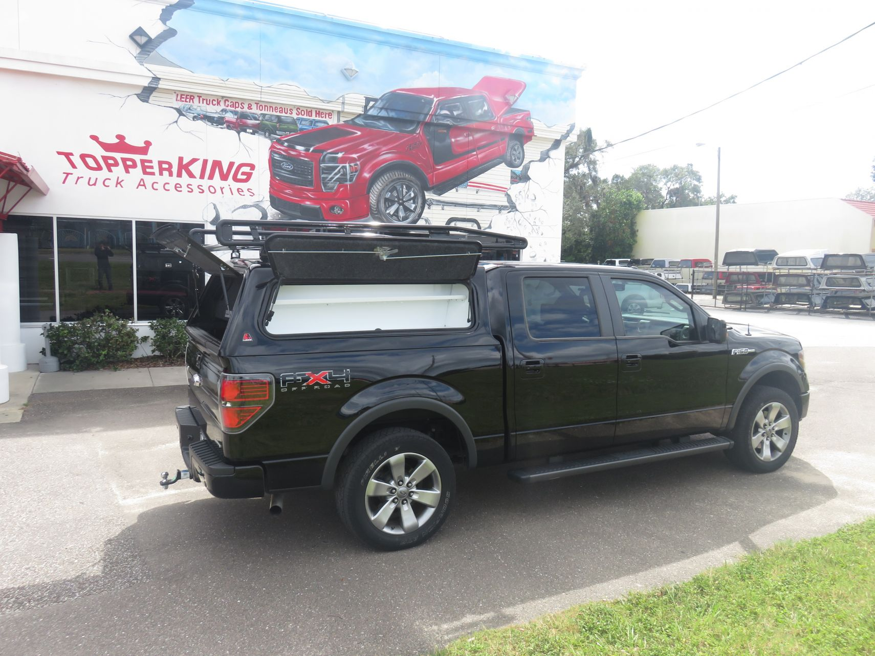 2014 Ford F150 with LEER 100RCC Work Topper, Commercial Roof Racks, Custom Hitch, Tint, Running Boards by TopperKING in Brandon, FL 813-689-2449 Call today!