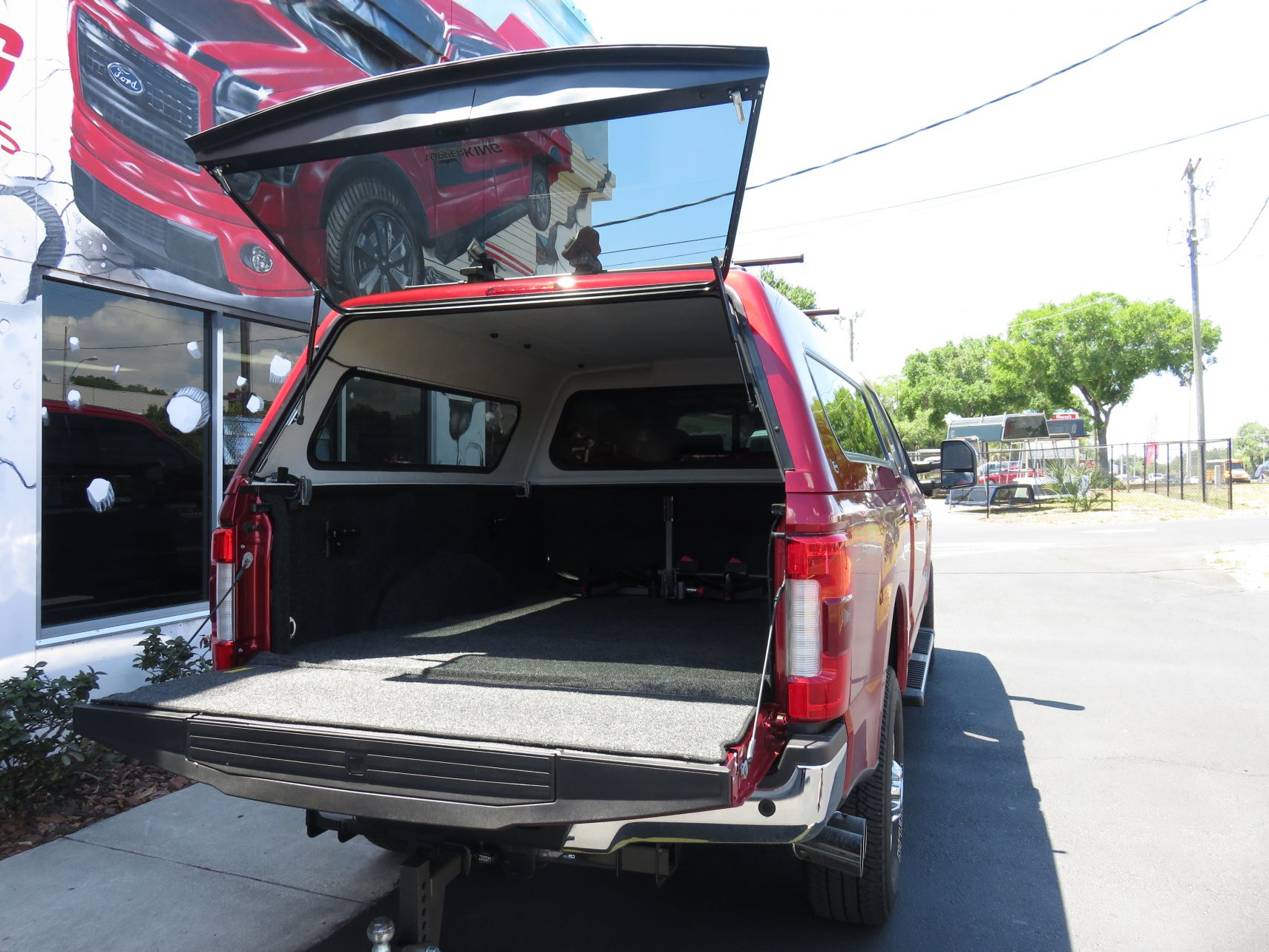 2018 Ford F250 with Ranch Echo, Roof Racks, BedRug, and Custom Hitch by TopperKING in Brandon, FL 813-689-2449 or Clearwater, FL 727-530-9066. Call today!