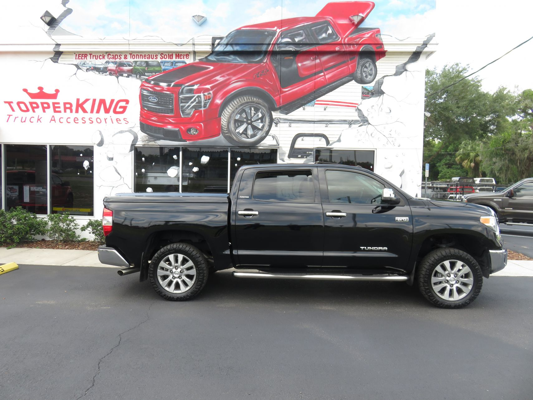 2018 Toyota Tundra LEER 700, Nerf Bars, Grill Guard, Chrome, and Hitch by TopperKING in Brandon, FL 813-689-2449 or Clearwater, FL 727-530-9066. Call today!
