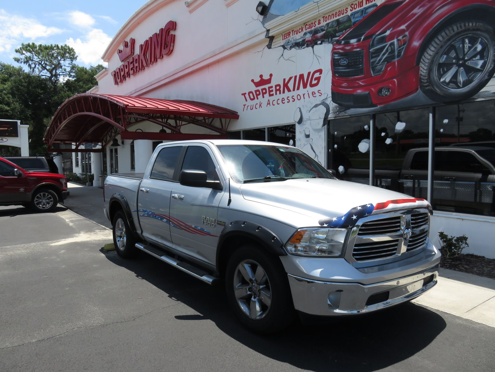 2015 Silver Dodge Ram 1500 Patriotic Decals and Hood Guard, LEER Trilogy X2T by TopperKING in Brandon, FL 813-689-2449 or Clearwater, FL 727-530-9066.