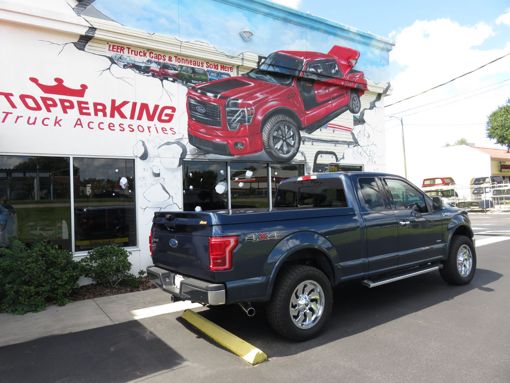 2017 Blue Ford F150 Leer 750 Sport, Chrome, Tint, Running boards, Custom Hitch by TopperKING in Brandon, FL 813-689-2449 or Clearwater, FL 727-530-9066.