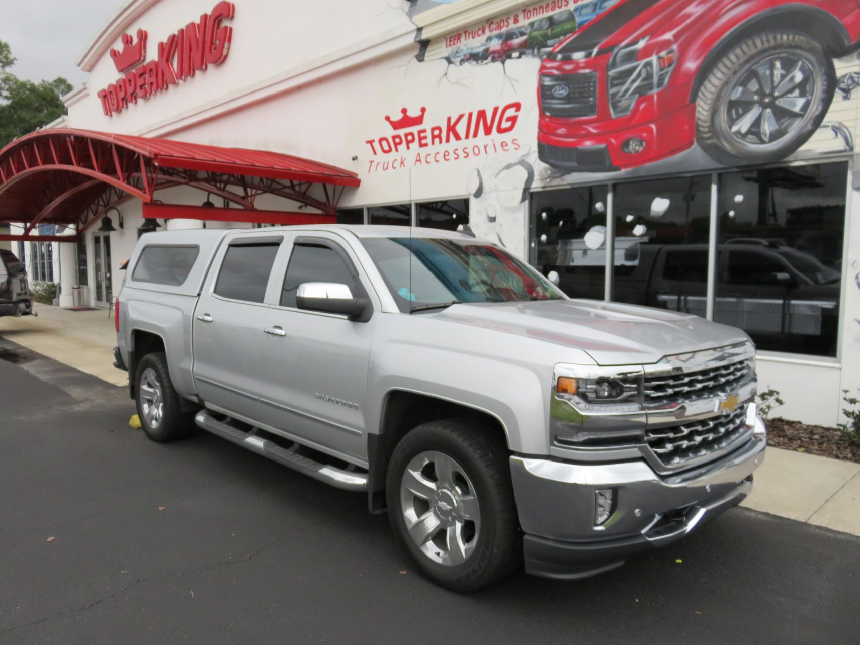 2018 Silver Chevy Silverado Ranch Echo, Nerf Bars, Hitch, Vent Visors by TopperKING in Brandon, FL 813-689-2449 or Clearwater, FL 727-530-9066. Call today!