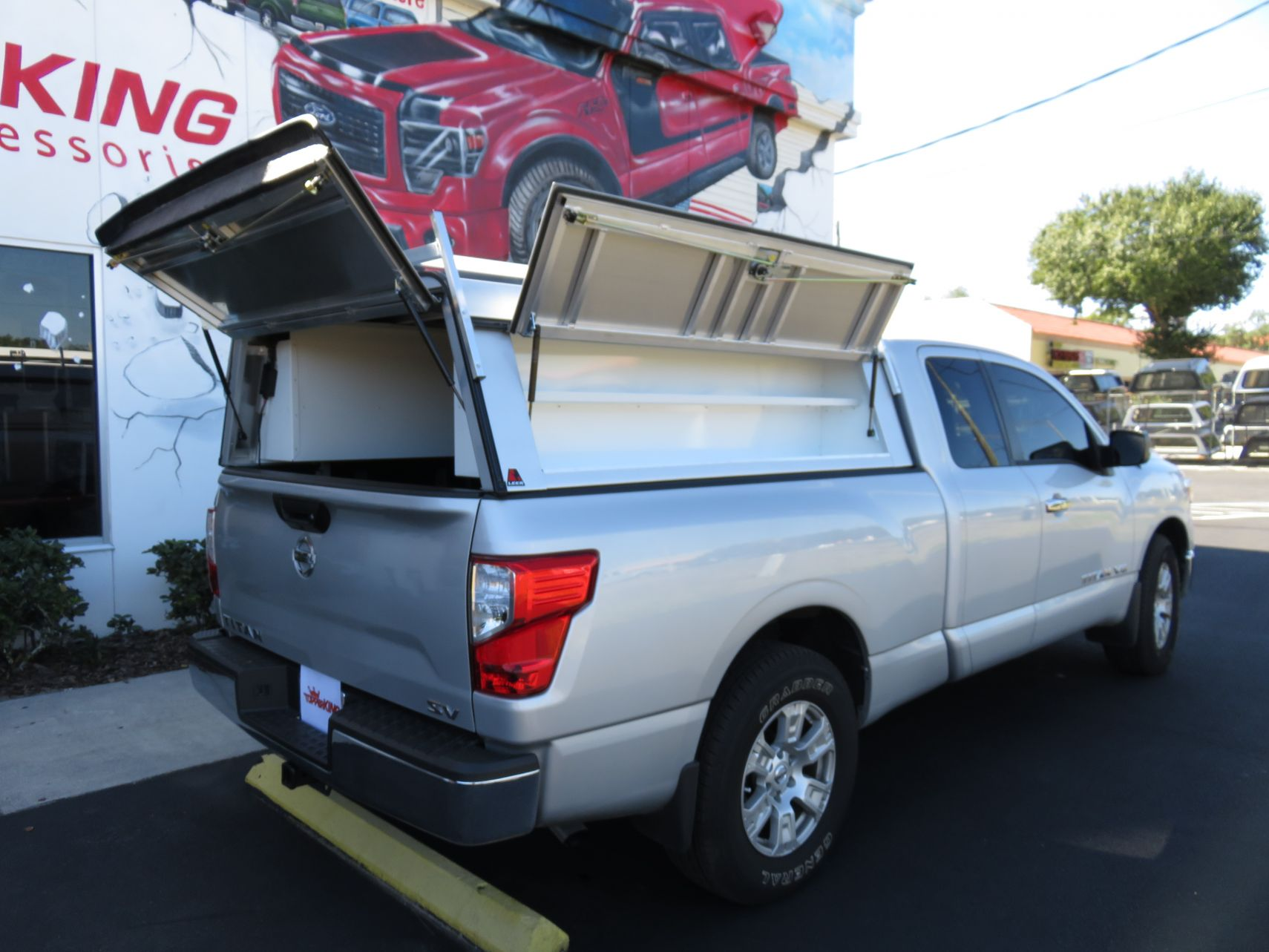 2018 Silver Nissan Titan LEER DCC Custom Hitch by TopperKING in Brandon, FL 813-689-2449 or Clearwater, FL 727-530-9066. Call today to start on your truck!