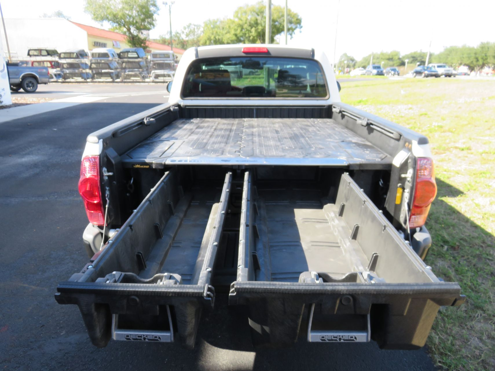 2010 Toyota Tacoma Decked by TopperKING in Brandon, FL 813-689-2449 or Clearwater, FL 727-530-9066. Call today to start on your truck!