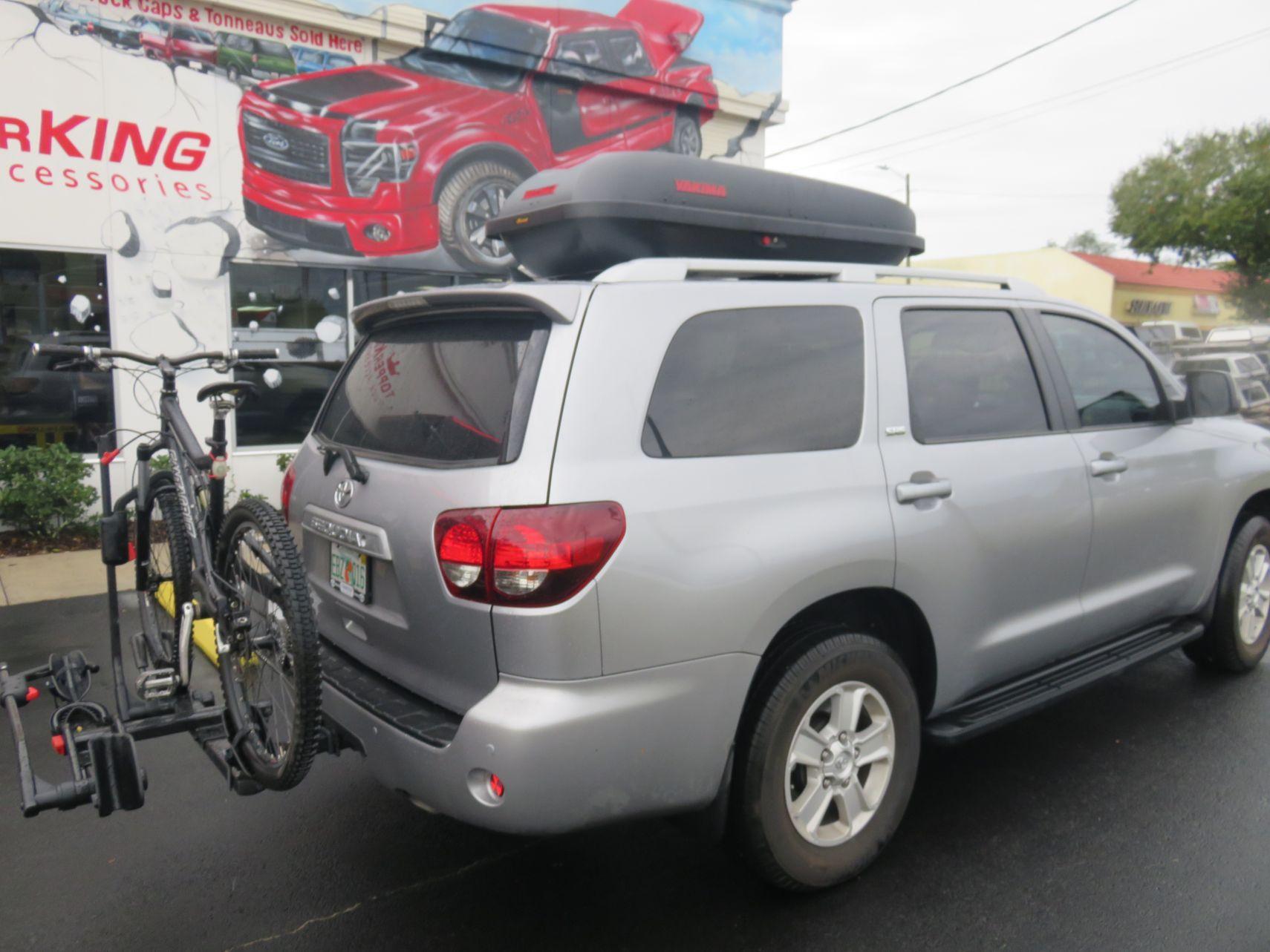 2018 Toyota Sequioa Yakima Storage Custom Hitch Bike Rack, Black out Nerf Bars by TopperKING in Brandon, FL 813-689-2449 or Clearwater, FL 727-530-9066.
