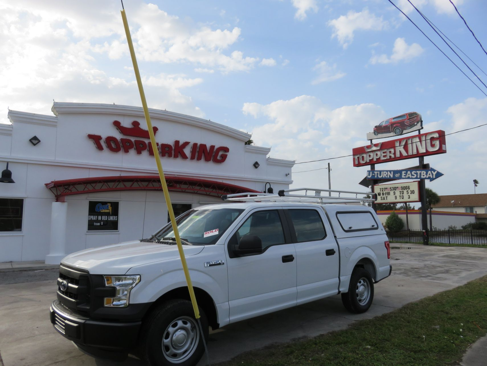 2015 White Ford F150 Ranch Sierra Solid Side Windows, Roof Racks, and Custom hitch by TopperKING in Brandon, FL 813-689-2449 or Clearwater, FL 727-530-9066.