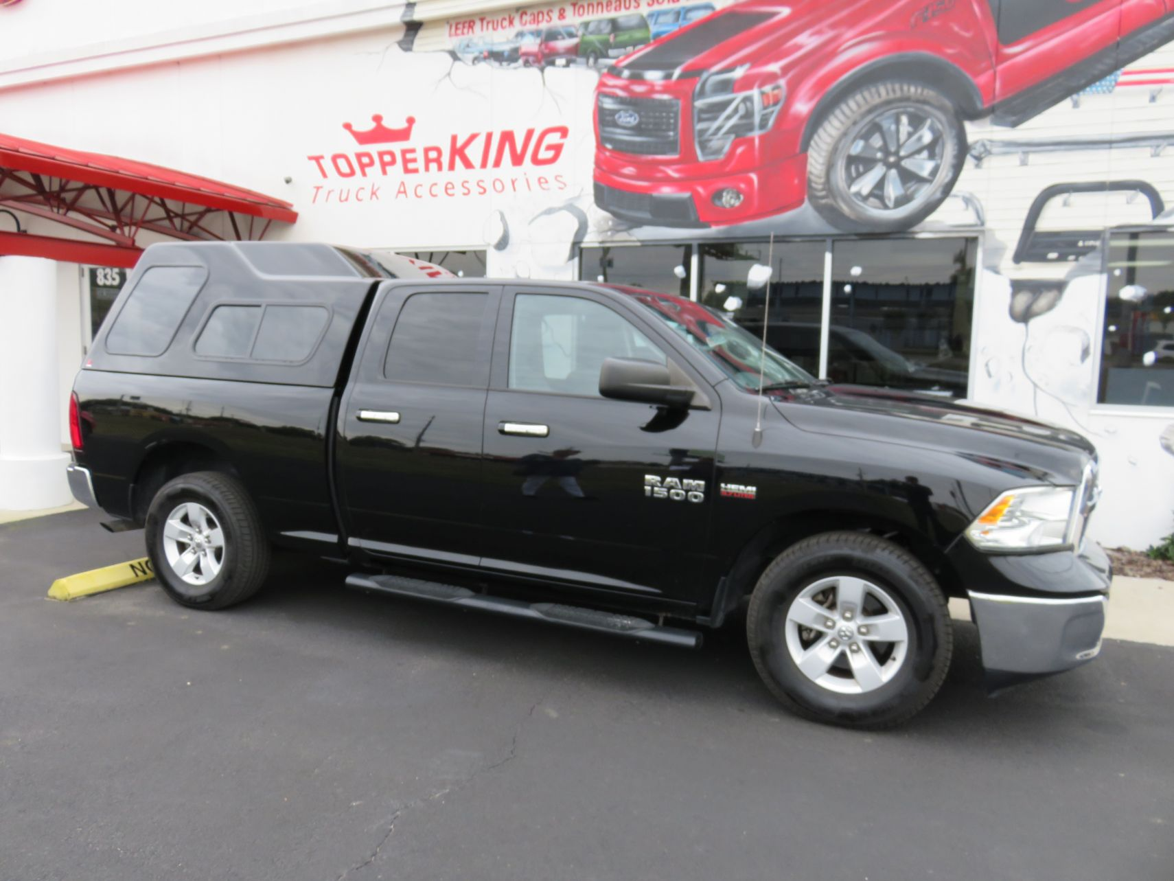 2018 Black Dodge Ram 1500 Leer 122, Nerf Bars, Tint, Custom Hitch by TopperKING in Brandon, FL 813-689-2449 or Clearwater, FL 727-530-9066. Call today!
