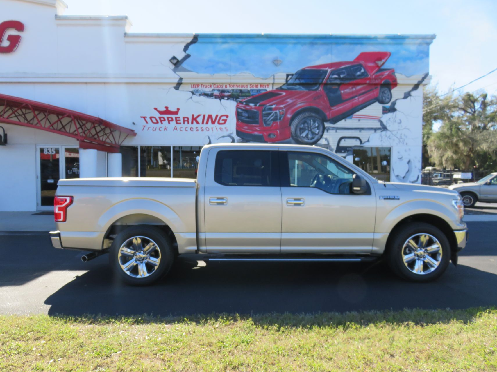 2019 Gold Ford F150 LEER 550, Tint, Nerf Bars, Bedliner, and Hitch by TopperKING in Brandon, FL 813-689-2449 or Clearwater, FL 727-530-9066. Call today!