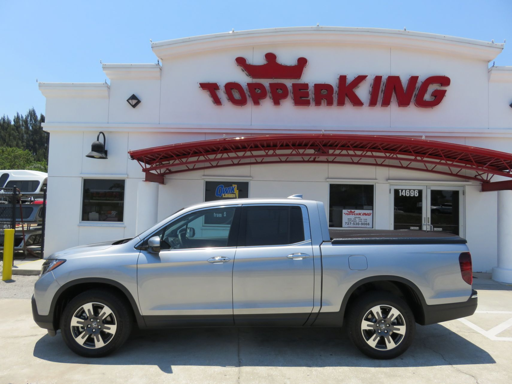 2019 Silver Honda Ridgeline Undercover Elite Tint Custom Hitch by TopperKING in Brandon, FL 813-689-2449 or Clearwater, FL 727-530-9066. Call today!
