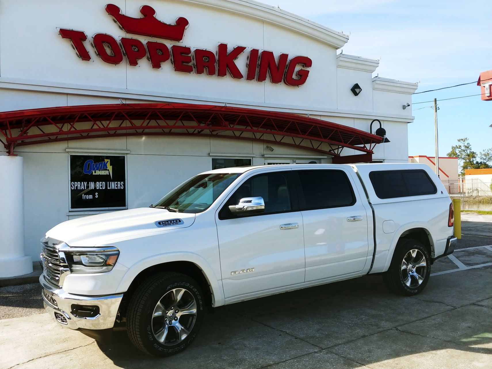 2019 White Dodge Ram 1500 LEER 100R, Custom Hitch, Chrome Accessories, and Tint by TopperKING in Brandon, FL 813-689-2449 or Clearwater, FL 727-530-9066.