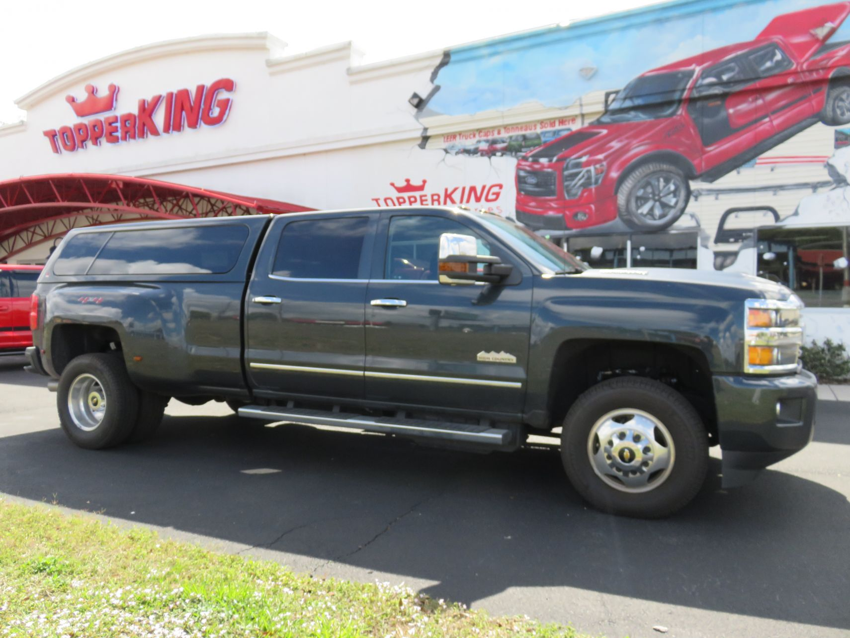 2018 Green Chevy Silverado LEER 100XL, Hitch, Tint, Nerf Bars by TopperKING in Brandon, FL 813-689-2449 or Clearwater, FL 727-530-9066. Call today to start!