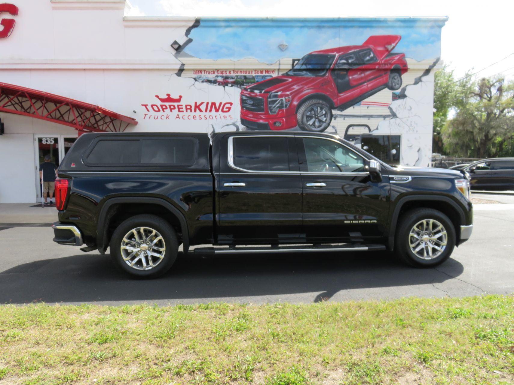 2019 Black GMC Sierra LEER 100XR, Hitch, Nerf Bars, Bug Guard, Tint by TopperKING in Brandon, FL 813-689-2449 or Clearwater, FL 727-530-9066. Call today!