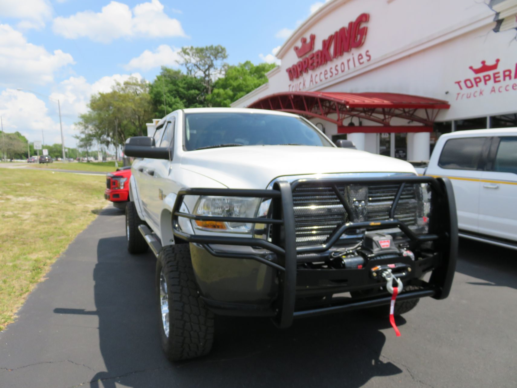 2011 White Dodge Ram Grill Guard, Winch, Vent Visors, Nerf Bars, Hitch, Tool Box by TopperKING in Brandon, FL 813-689-2449 or Clearwater, FL 727-530-9066.