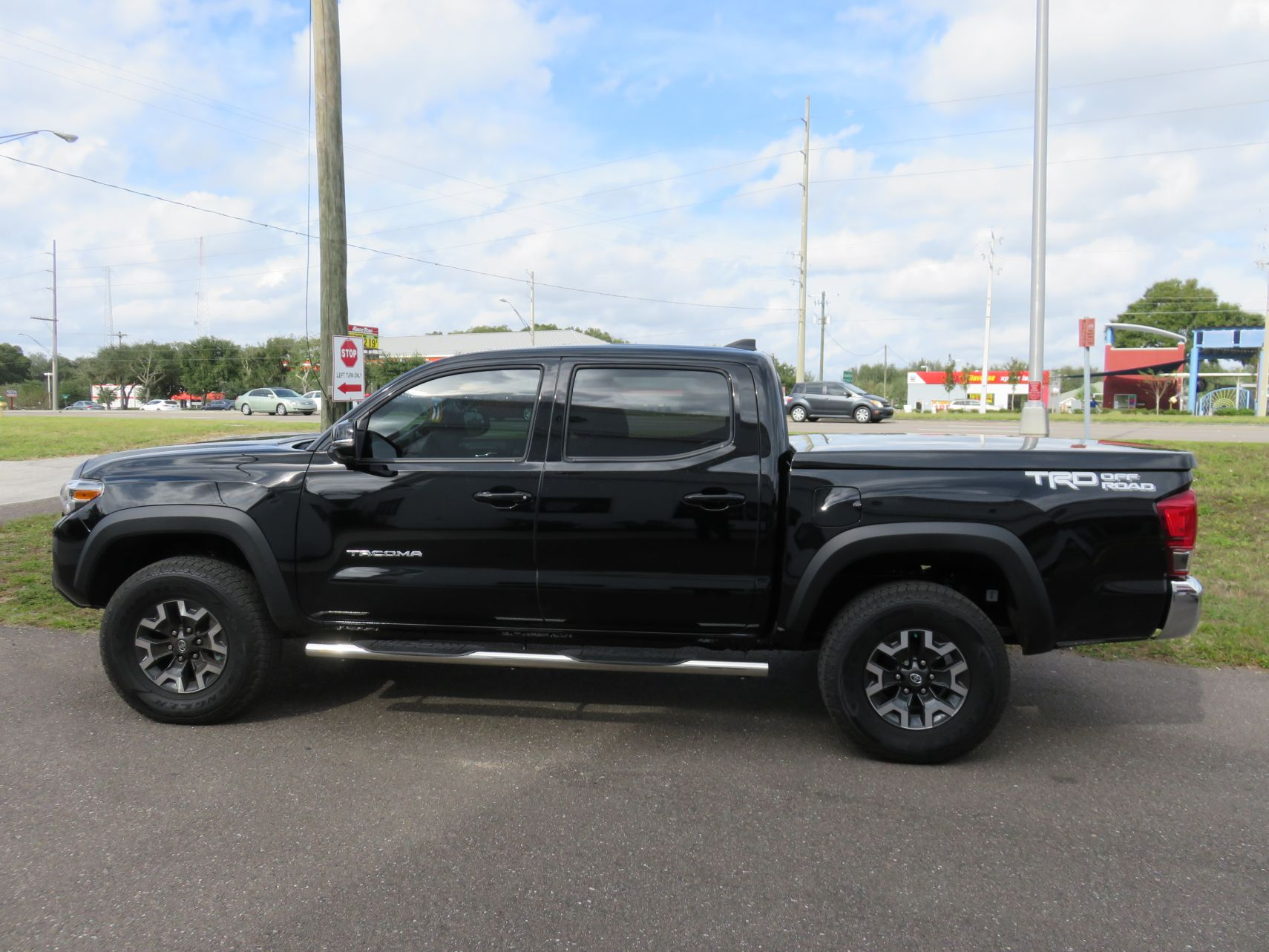 2016 Black Toyota Tacoma Leer 550 Fiberglass Tonneau Cover Topperking Topperking Providing All Of Tampa Bay With Quality Truck Accessories