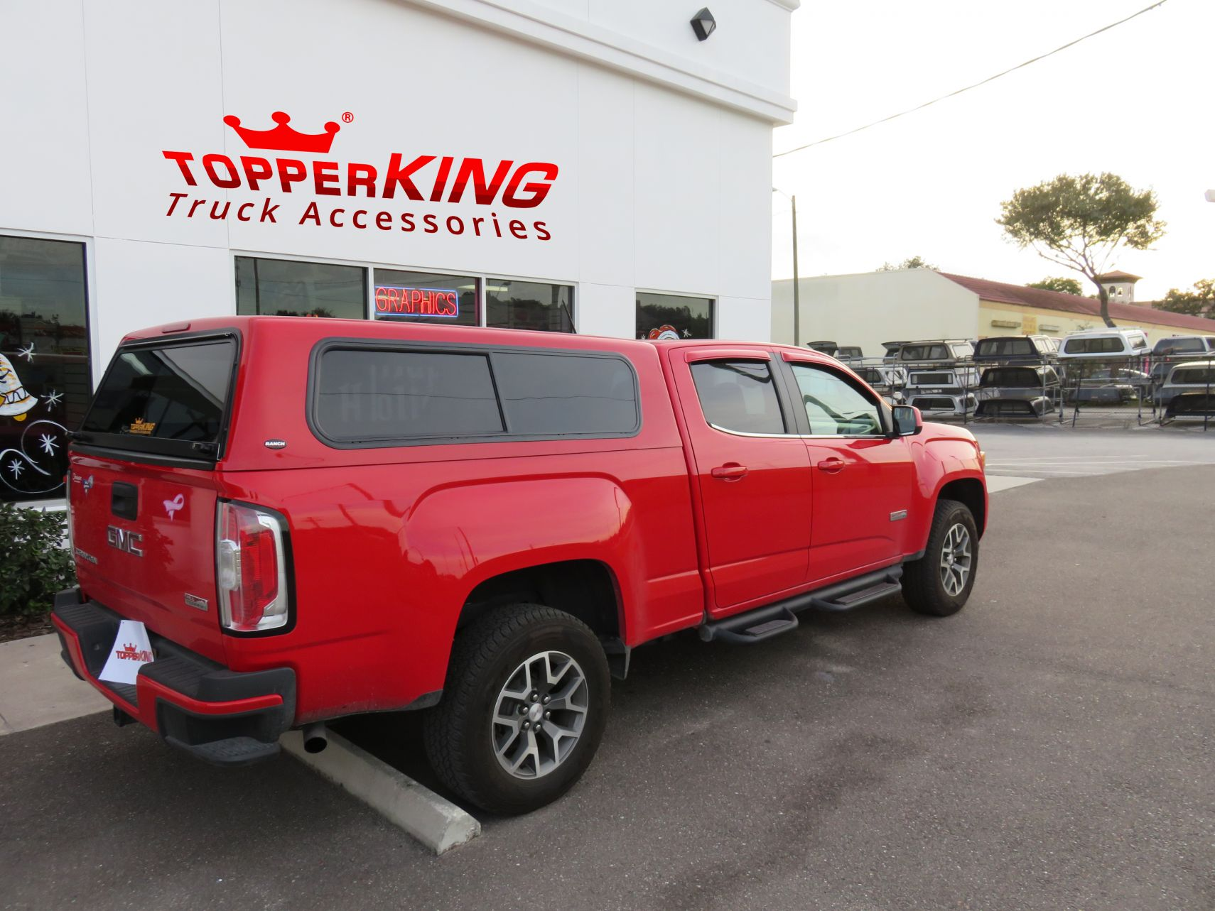 GMC Canyon Ranch Sierrafiberglass topper and a custom hitch by TopperKING in Brandon, FL 813-689-2449 Call today to start on your truck!
