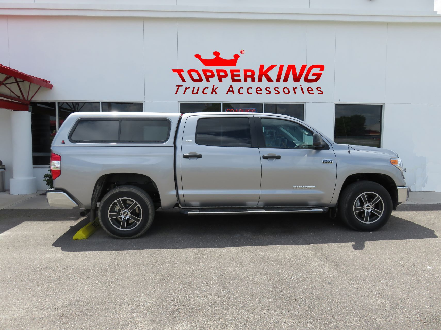 2015 Toyota Tundrawith LEER 100XR Fiberglass Topper Nerf Bars, Hitch, Tint by TopperKING Brandon 813-689-2449 or Clearwater FL 727-530-9066.