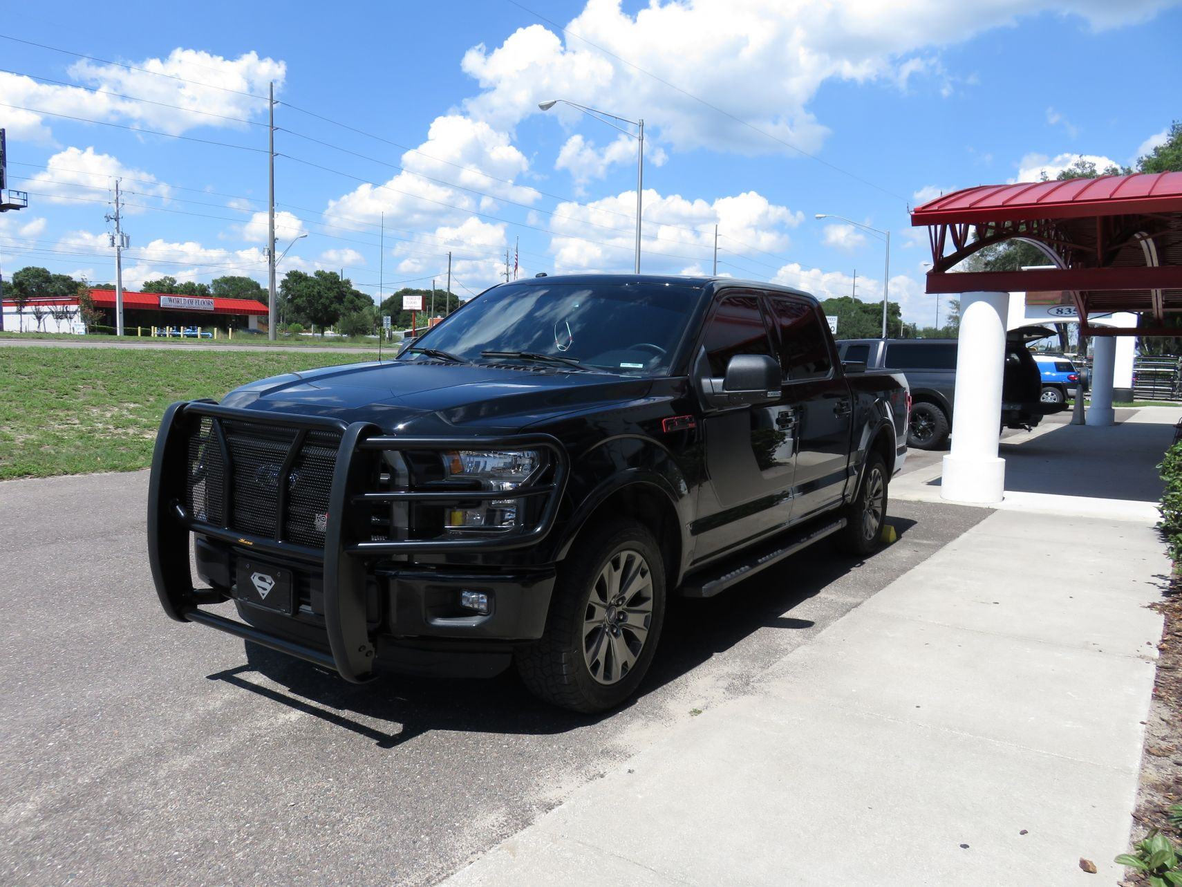 Blacked Out Ford F150 >> Blacked Out 2017 Ford F150 with Grille Guard - TopperKING : TopperKING | Providing all of Tampa ...