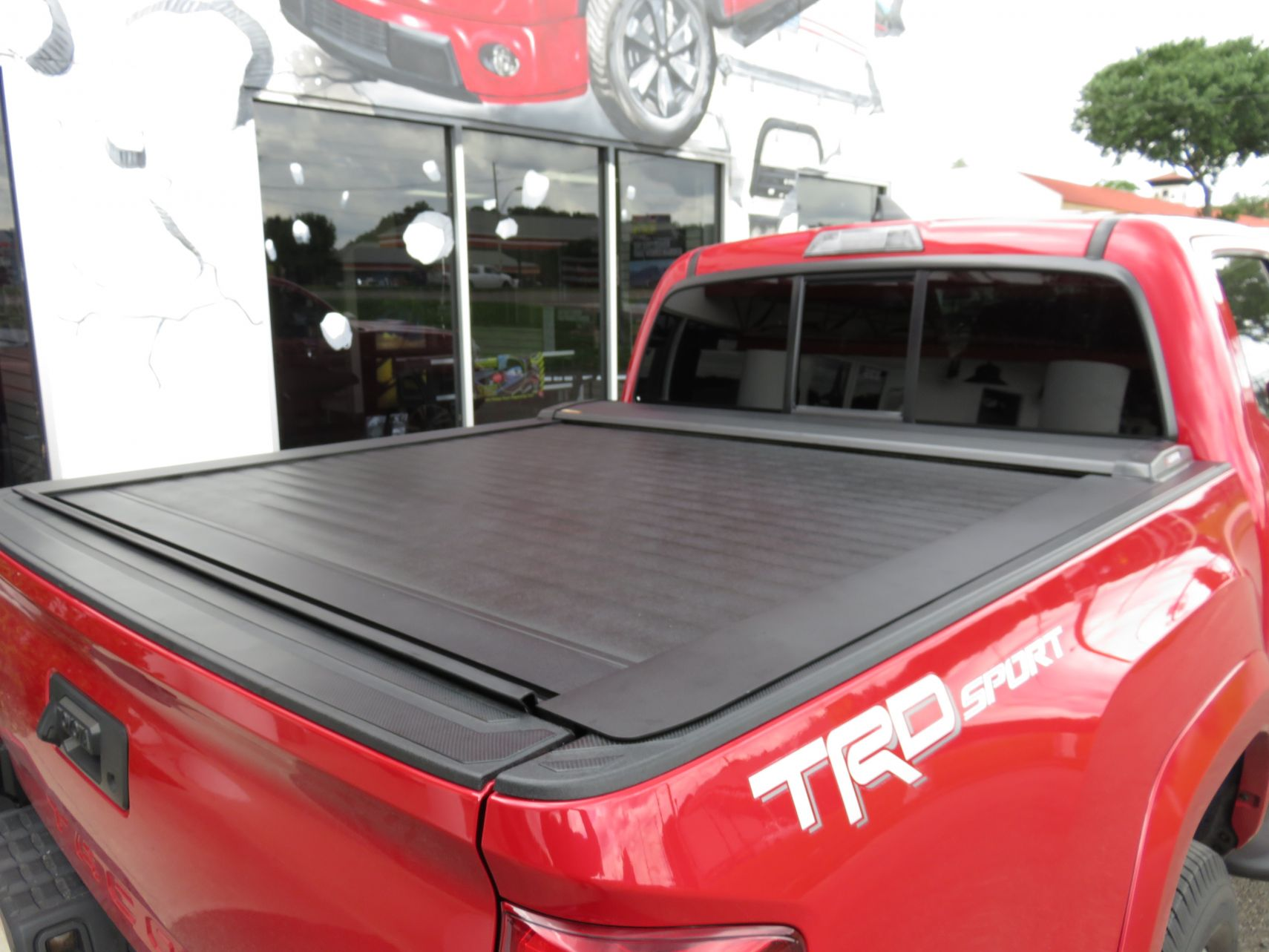 2017 Red Toyota Tacoma Leer Ricochet Cover Topperking Topperking Providing All Of Tampa Bay With Quality Truck Accessories