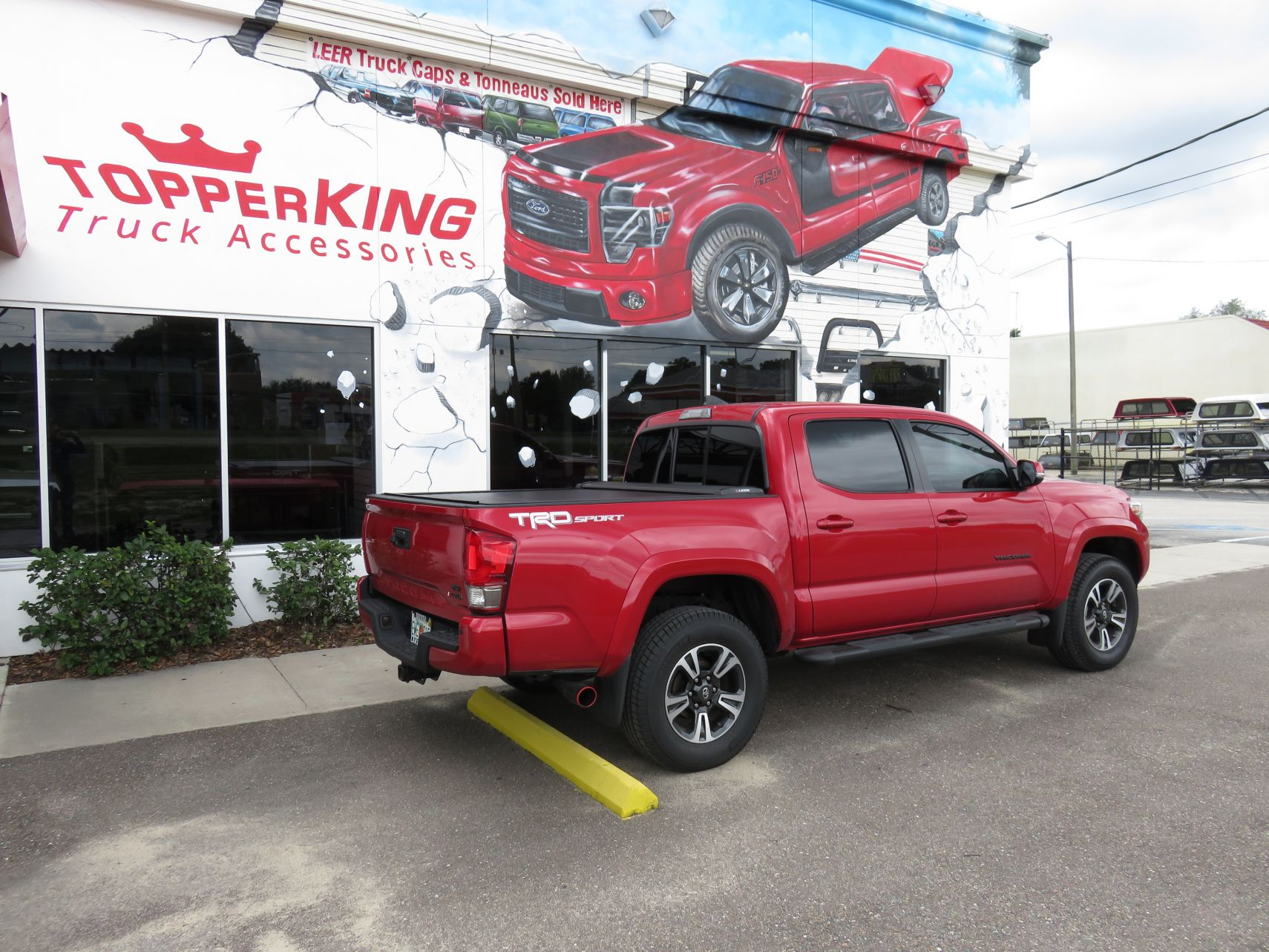 2017 Toyota Tacoma with LEER Ricochet, Black Out Nerf Bars, Tint, Hitch by TopperKING in Brandon, FL 813-689-2449 or Clearwater, FL 727-530-9066. Call Now!