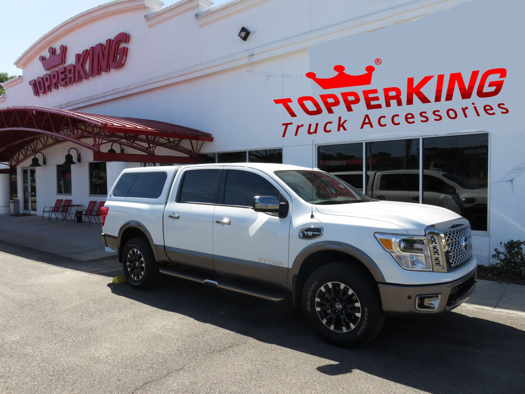 Nissan Titan with LEER 100XL, side steps, chrome accessories, and custom hitch by TopperKING in Brandon, FL 813-689-2449 Call today to start on your truck!