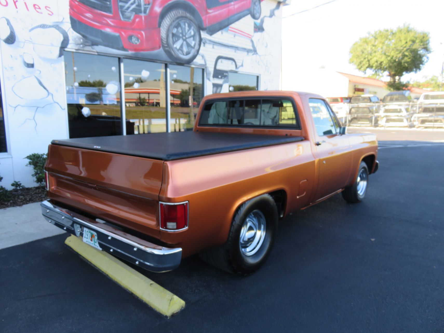1979 Copper GMC Truxedo Truxport by TopperKING in Brandon, FL 813-689-2449 or Clearwater, FL 727-530-9066. Call today to start on your truck!