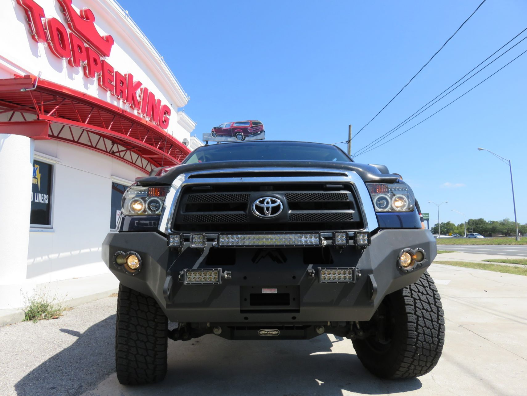 2013 Toyota Tundra with Ranch SportWrap, Lighted Bumper, Side Steps. Call TopperKING Brandon 813-689-2449 or Clearwater FL 727-530-9066.