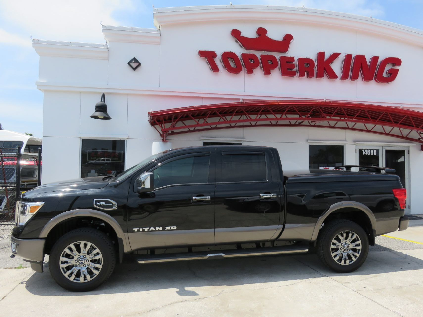 2018 Black Nissan Titan Ranch Legacy, Running Boards, Vent Visors, and Tint by TopperKING in Brandon, FL 813-689-2449 or Clearwater, FL 727-530-9066.