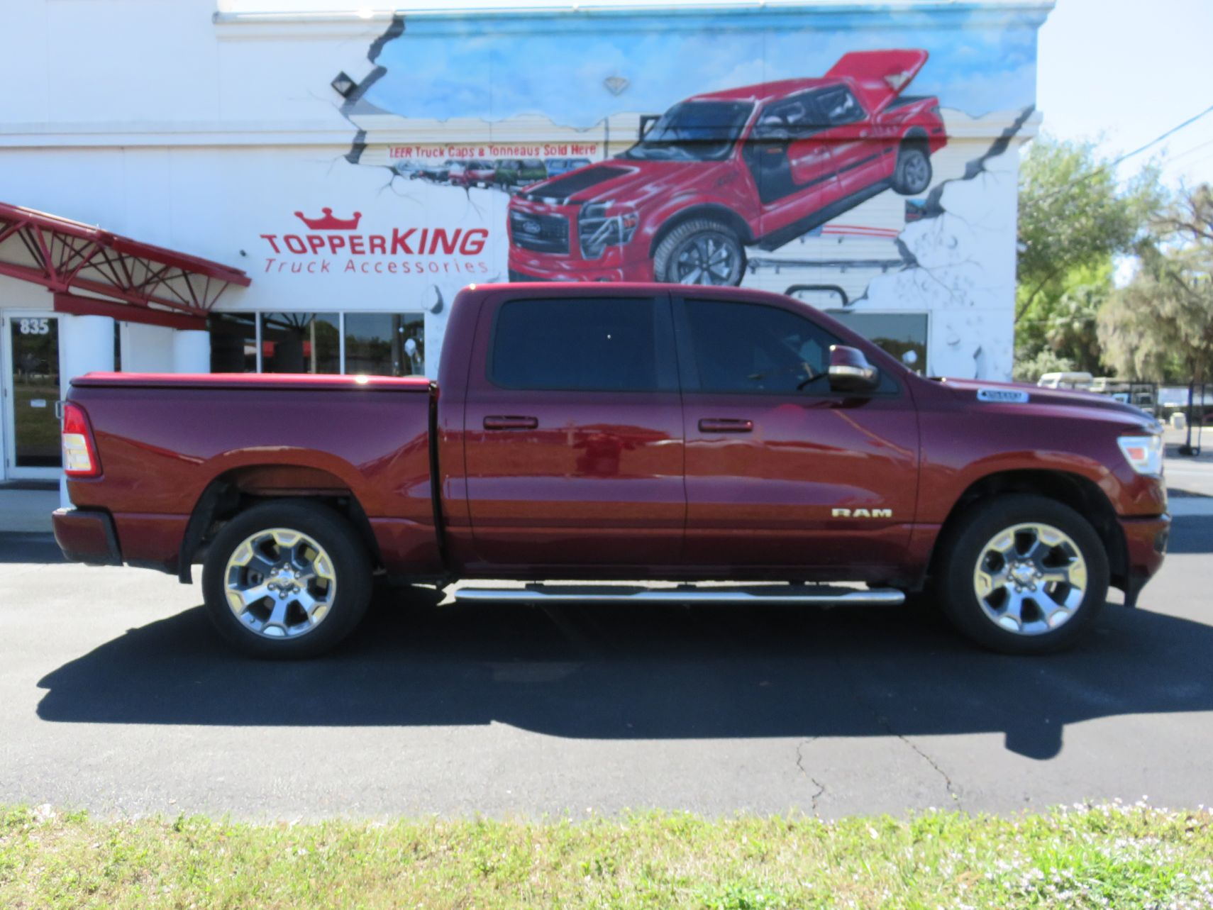 2019 Red Dodge Ram Undercover LUX, Nerf Bars, Hitch, Tint by TopperKING in Brandon, FL 813-689-2449 or Clearwater, FL 727-530-9066. Call today to start!