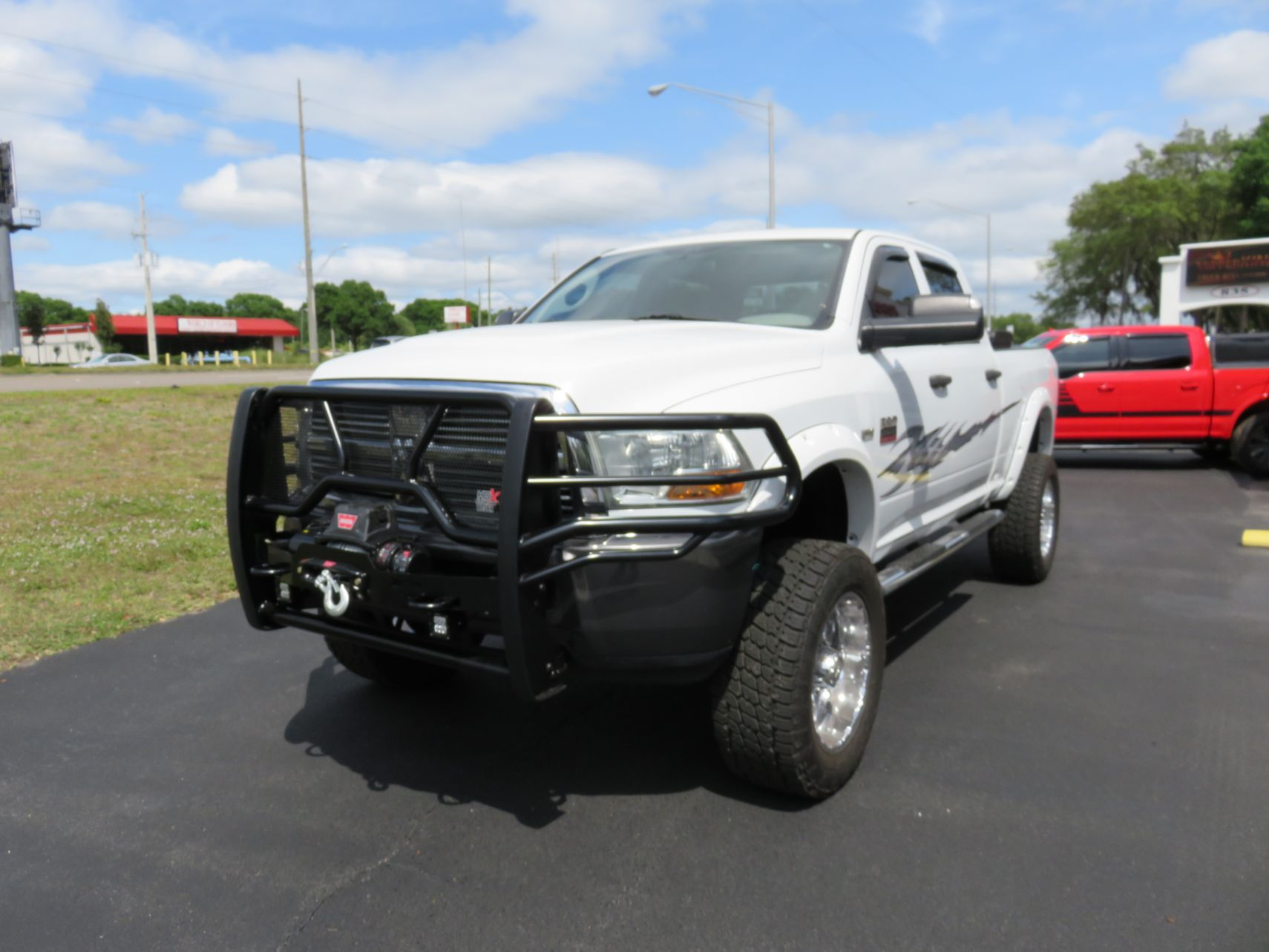 2011 Dodge Ram with Graphics, Grill Guard, Tool Box, Vent Visors, Hitch by TopperKING in Brandon FL 813-689-2449 or Clearwater FL 727-530-9066. Call today!