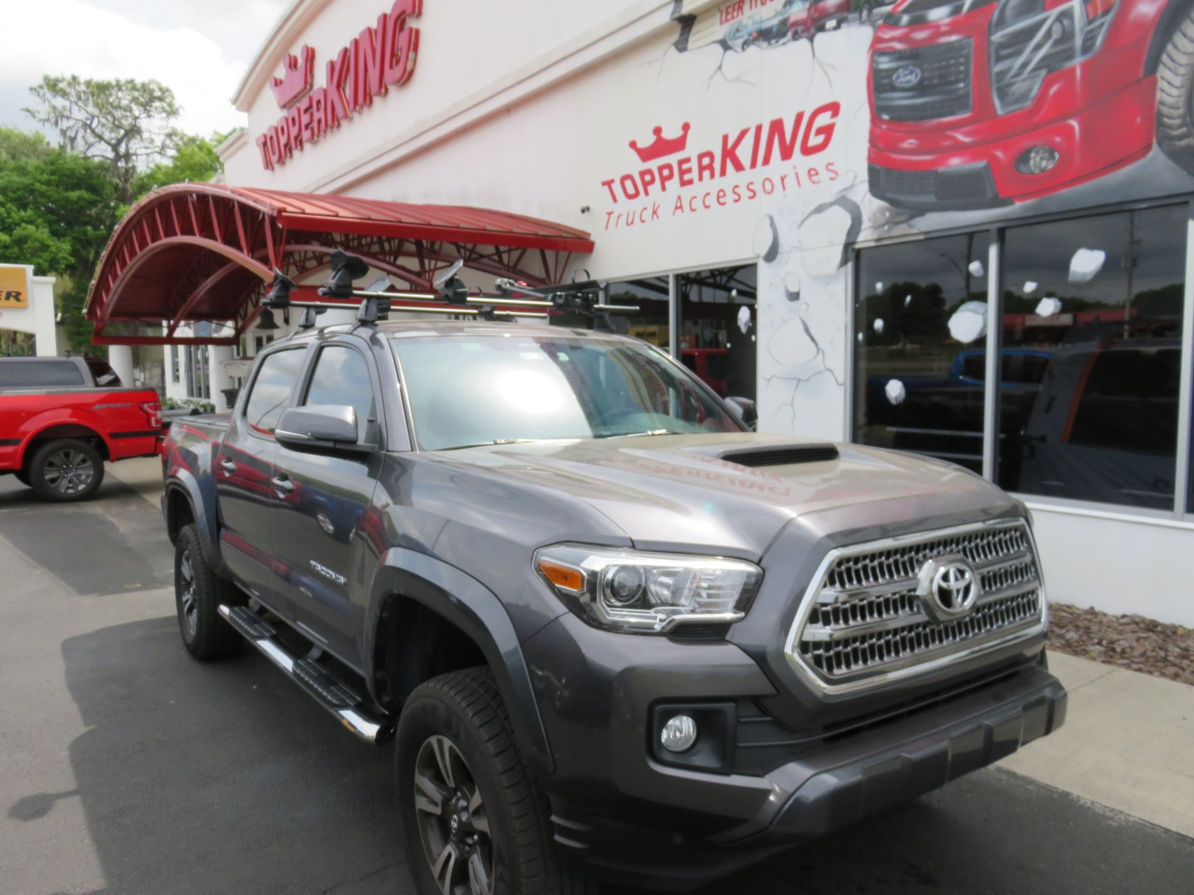 2019 Toyota Tacoma with LEER 350M, Yakima Rack, Nerf Bars, Hitch, Tint. Call TopperKING Brandon 813-689-2449 or Clearwater FL 727-530-9066.