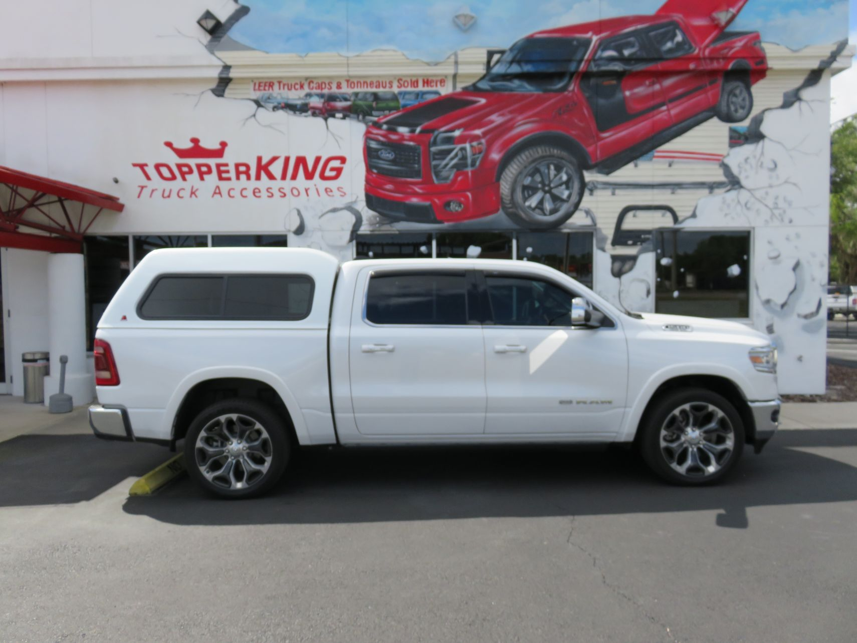 2019 White Dodge Ram 1500 LEER 180, Hitch, Tint, Vent Visors, Chrome by TopperKING in Brandon, FL 813-689-2449 or Clearwater, FL 727-530-9066. Call today!