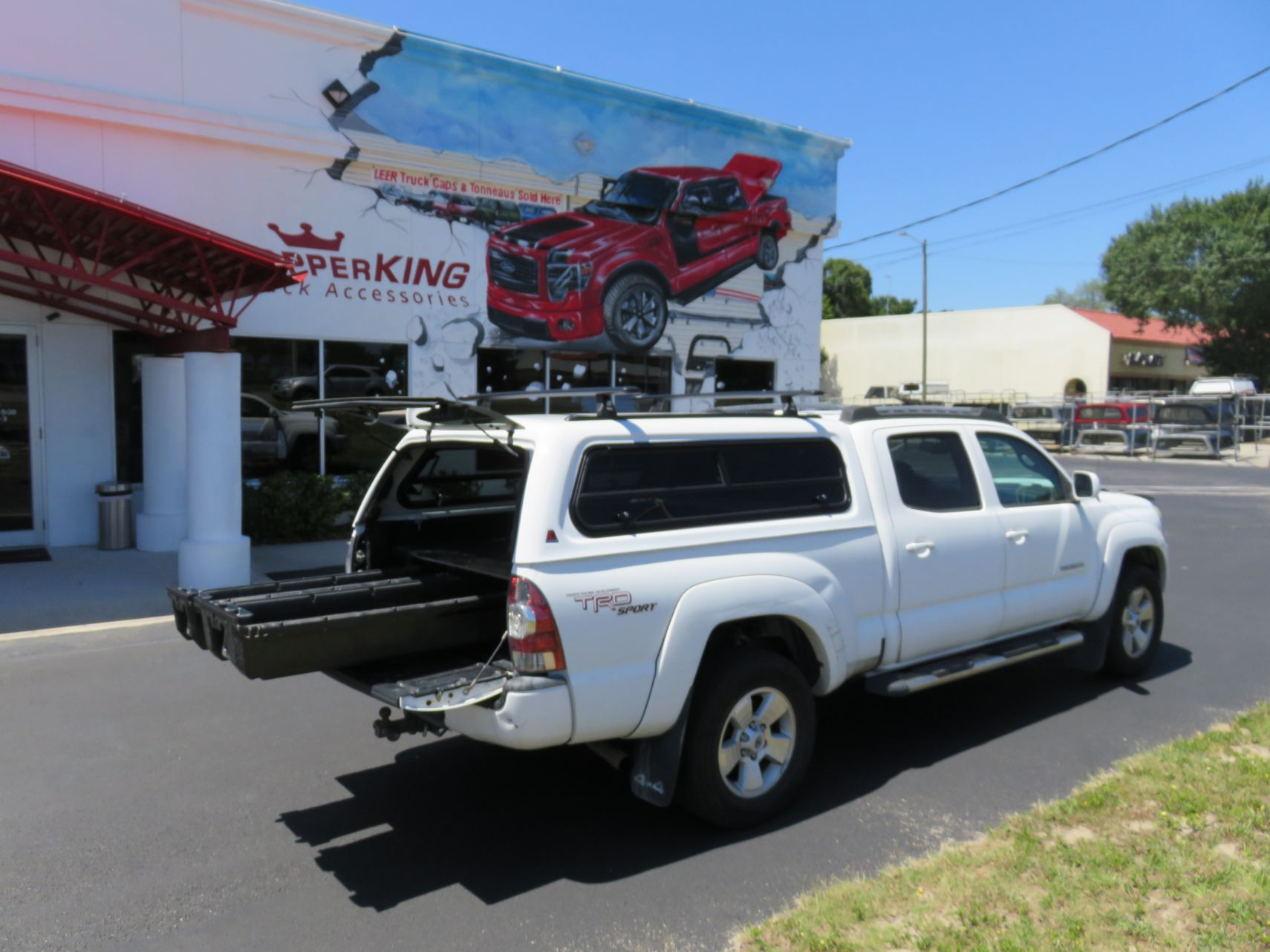 2014 Tacoma with LEER 100XR Decked, Nerf Bars, Roof Racks, Bug Guard, Hitch, Tint. TopperKING Brandon 813-689-2449 or Clearwater 727-530-9066