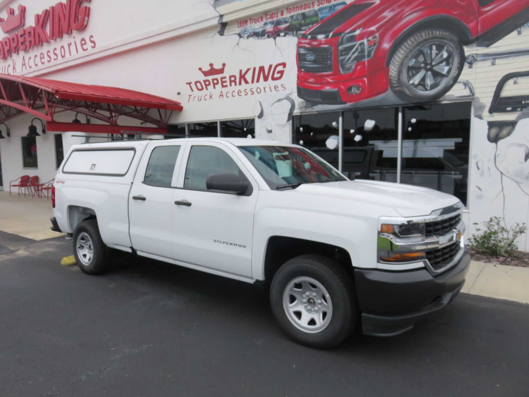 2018 Chevy Silverado with LEER 100RCC, Roof Rack, and Custom Hitch by TopperKING in Brandon, FL 813-689-2449 or Clearwater, FL 727-530-9066. Call today!