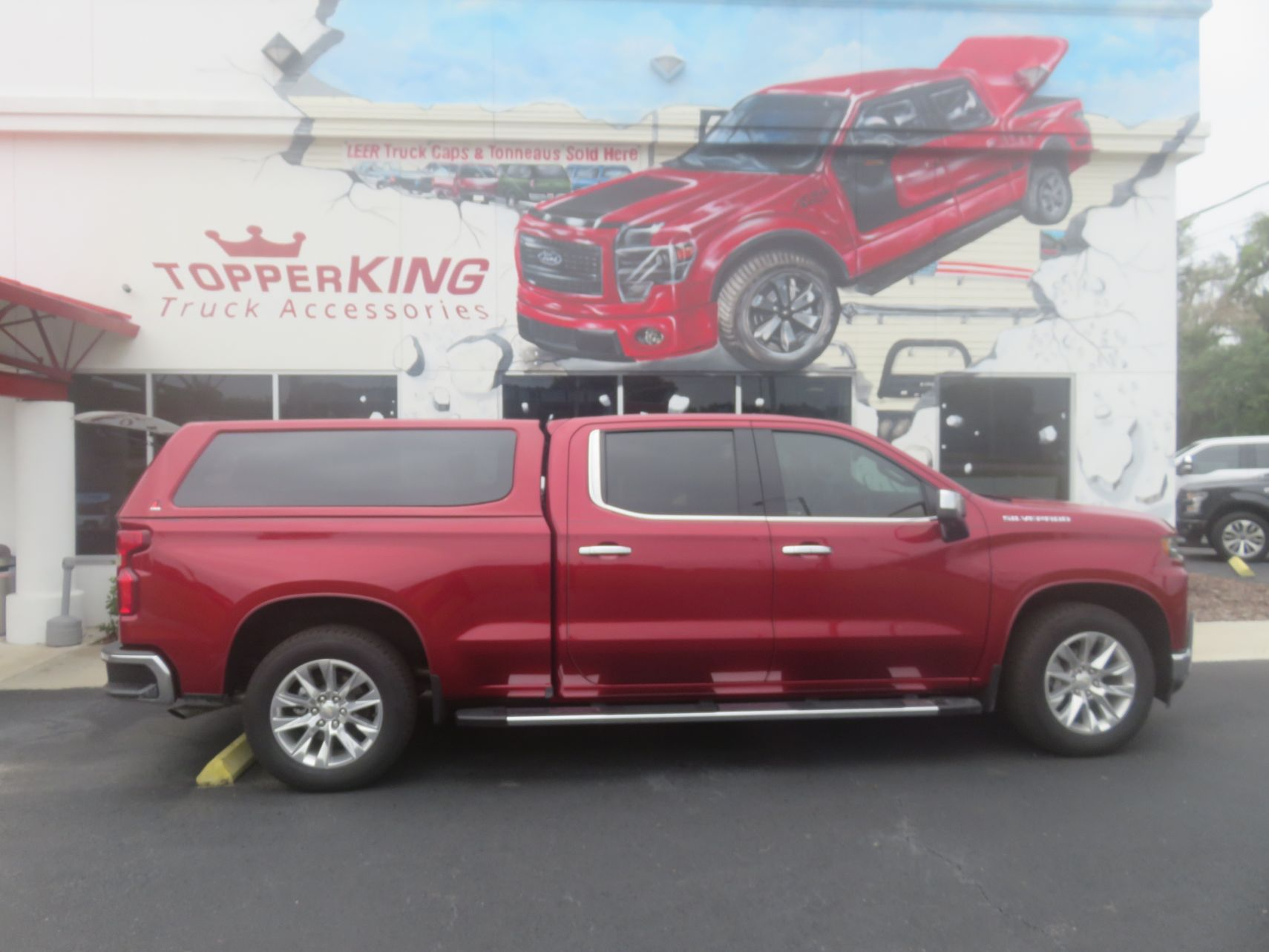 2019 Chevy Silverado with LEER 100XQ, Nerf Bars, Hitch, and Tint by TopperKING in Brandon, FL 813-689-2449 or Clearwater, FL 727-530-9066. Call today!