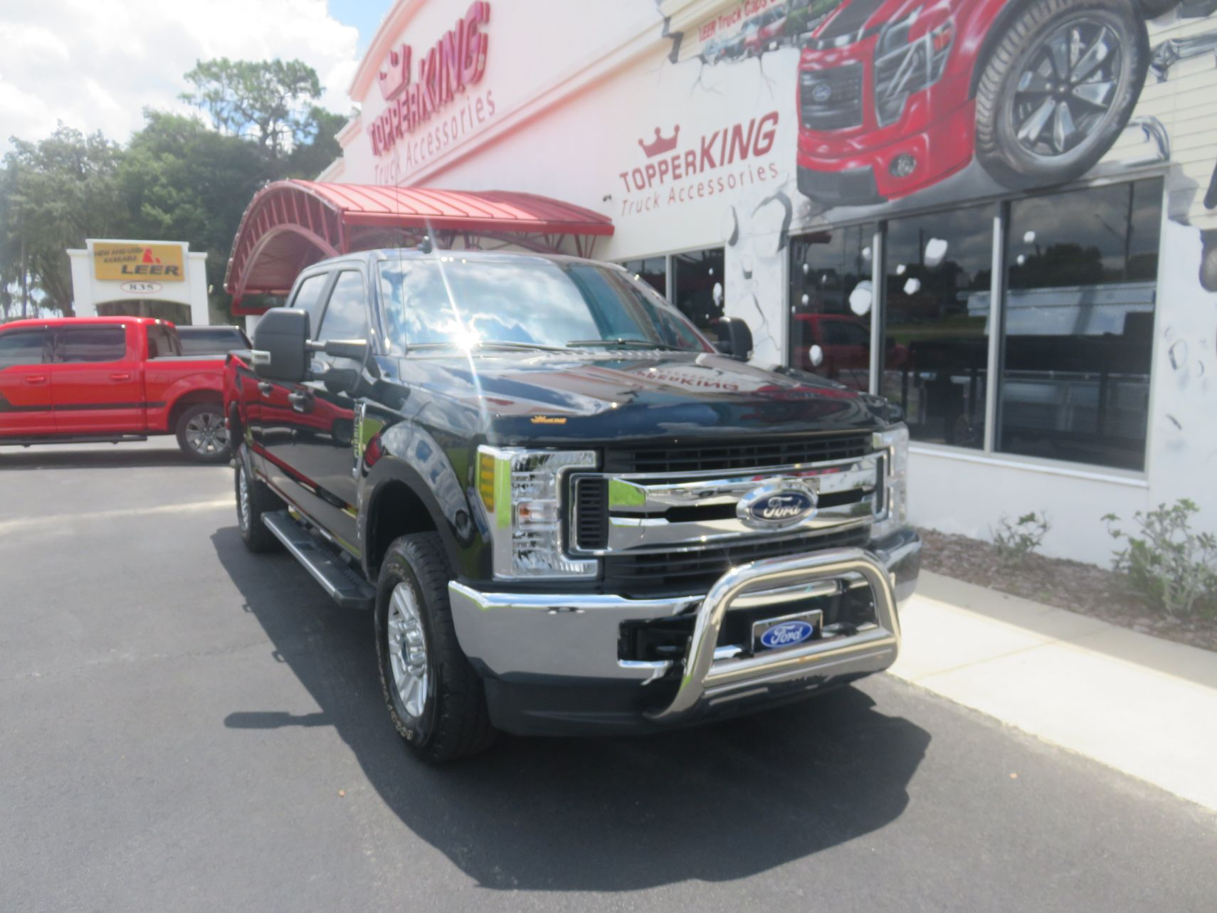 2019 F250 with Bull Bar, Adjustable Hitch, Nerf Bars, Bug Guard by TopperKING in Brandon, FL 813-689-2449 or Clearwater, FL 727-530-9066. Call today!