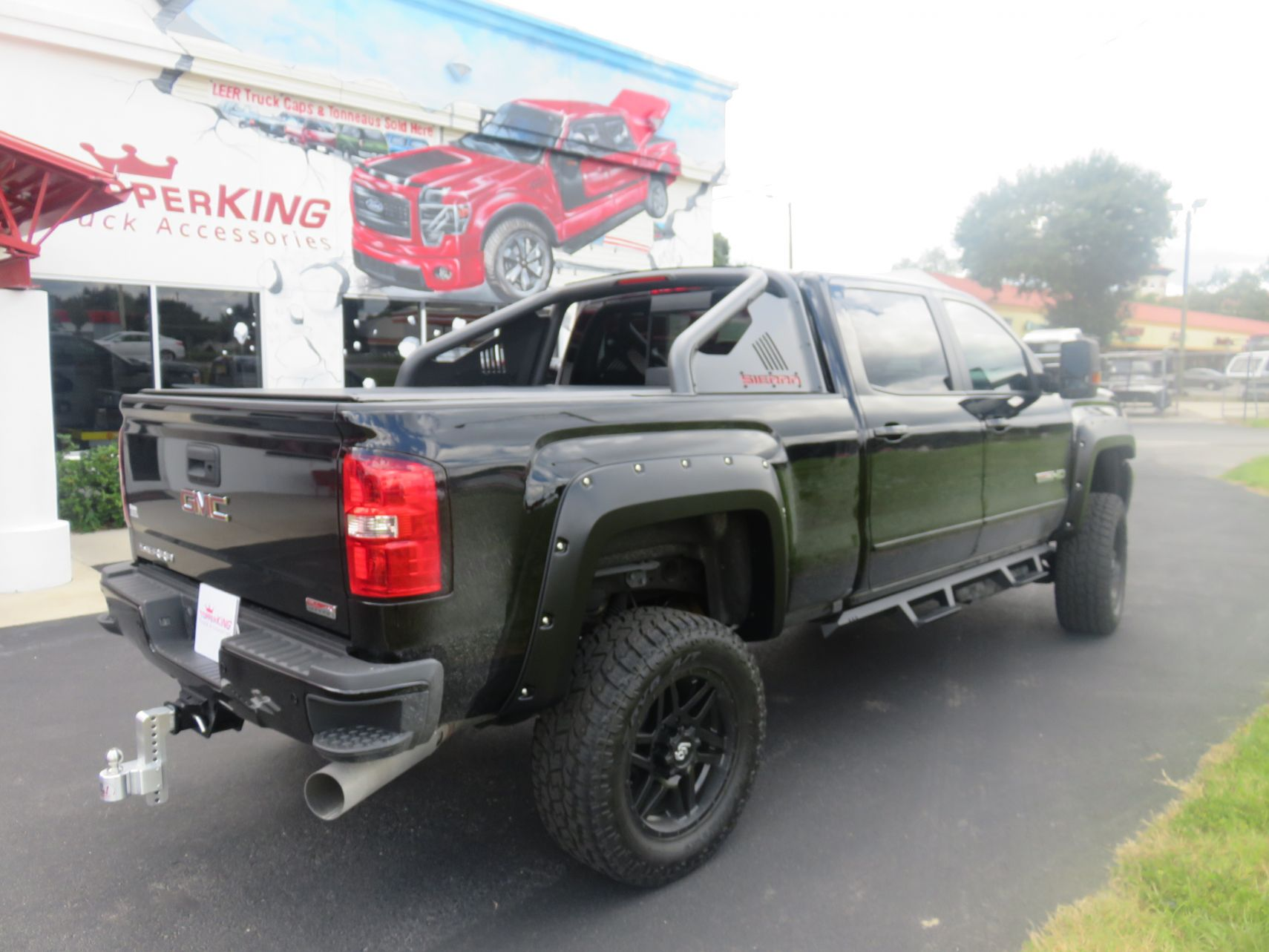 2019 GMC Sierra with Truxedo, Nerf Bars, Fender Flares, and hitch by TopperKING in Brandon, FL 813-689-2449 or Clearwater, FL 727-530-9066. Call today!