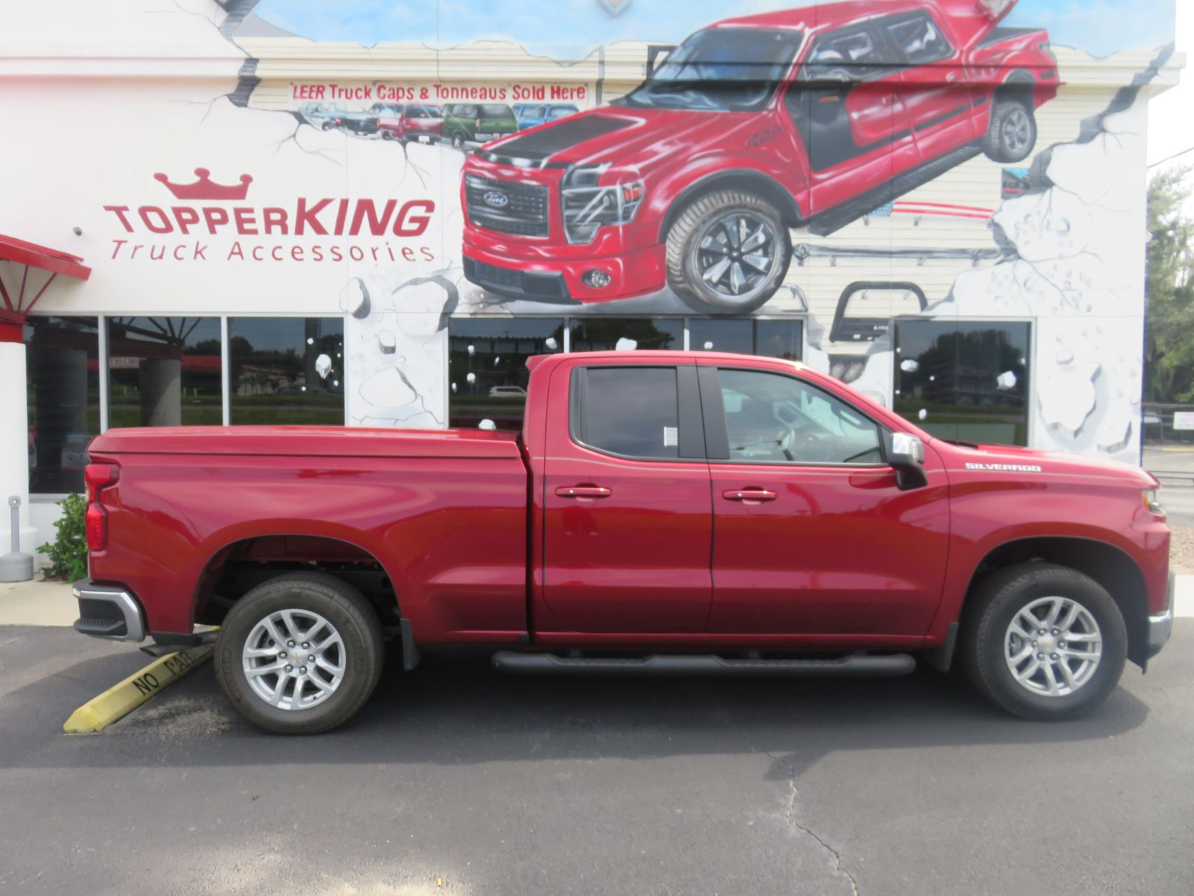 2019 Chevy Silverado with LEER 700, Blackout Nerf Bars, and Hitch, by TopperKING in Brandon, FL 813-689-2449 or Clearwater, FL 727-530-9066. Call today!