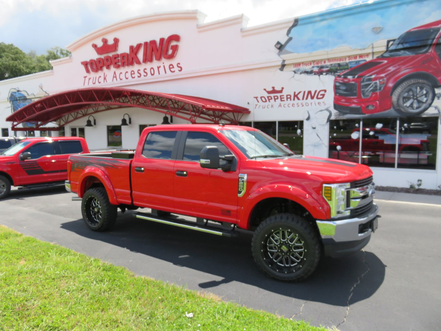2019 Ford F250 with Fender Flares, Tool Box, Hitch, Nerf Bars, and Graphics by by TopperKING in Brandon, FL 813-689-2449 or Clearwater, FL 727-530-9066!
