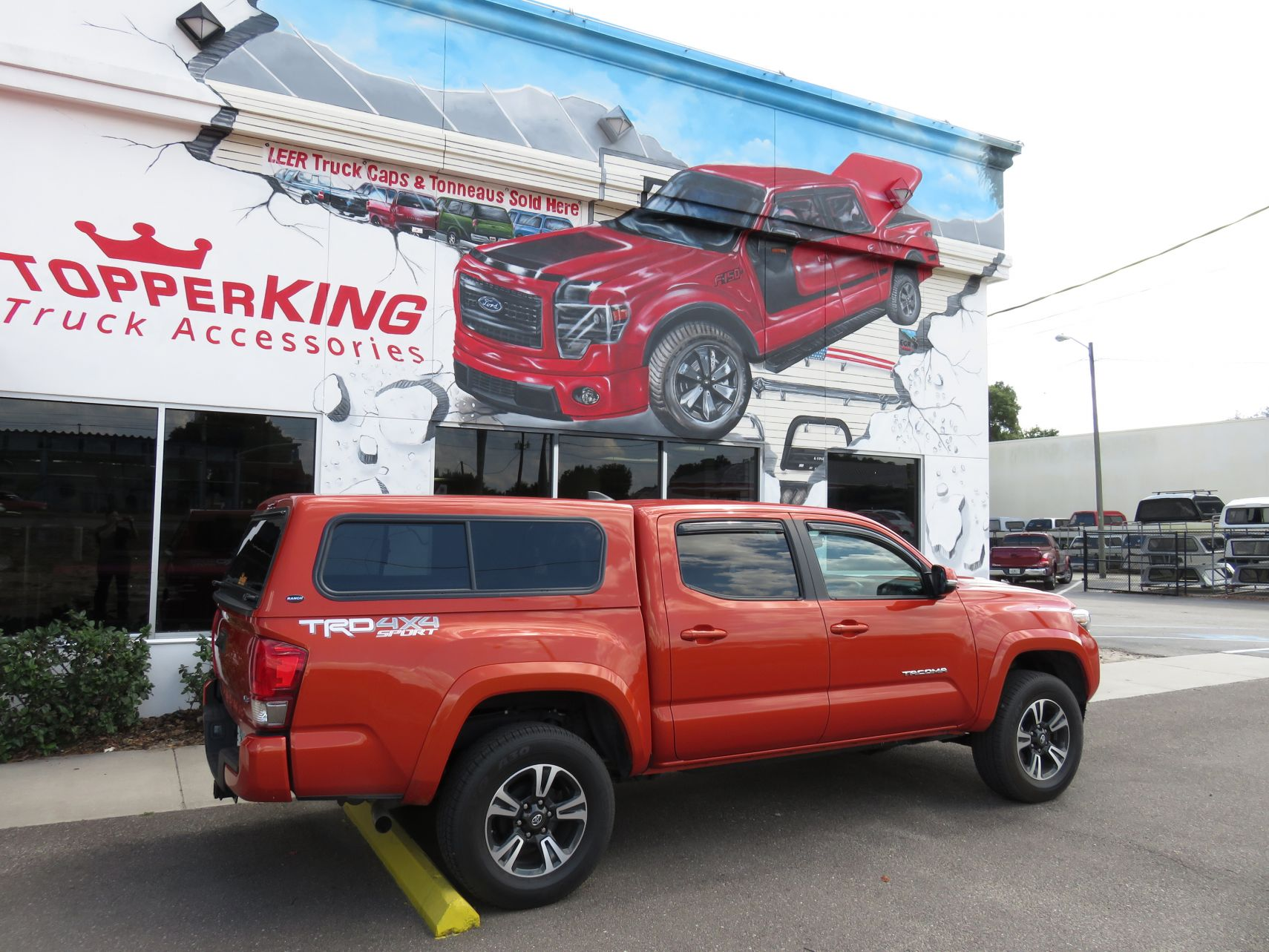 2017 Toyota Tacoma with Ranch Sierra, Hitch, Vent Visors, Bedliner by TopperKING in Brandon, FL 813-689-2449 or Clearwater, FL 727-530-9066. Call today!