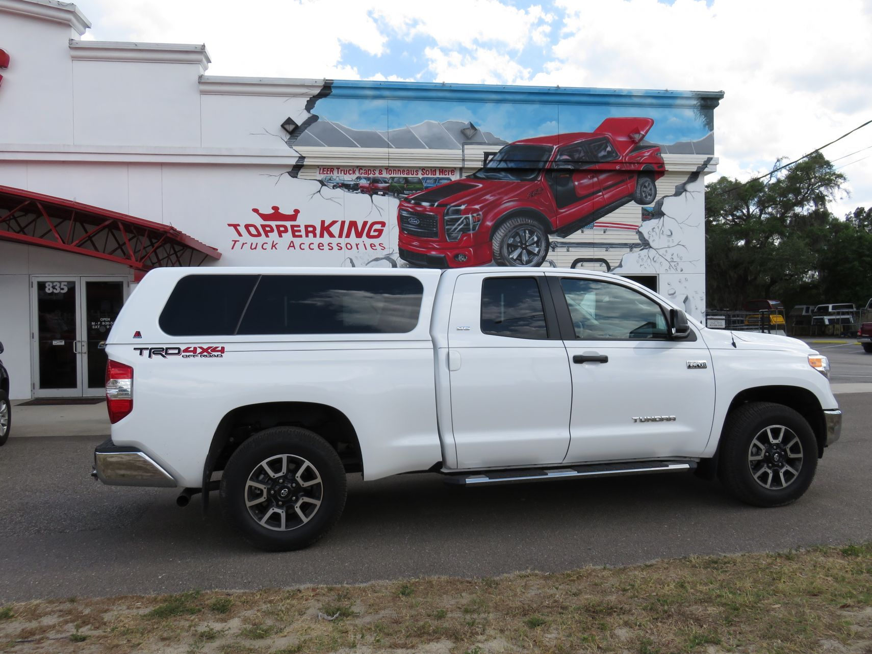 2018 Toyota Tundra with LEER 100XL, Running Boards, Custom Hitch by TopperKING in Brandon, FL 813-689-2449 or Clearwater, FL 727-530-9066. Call today!